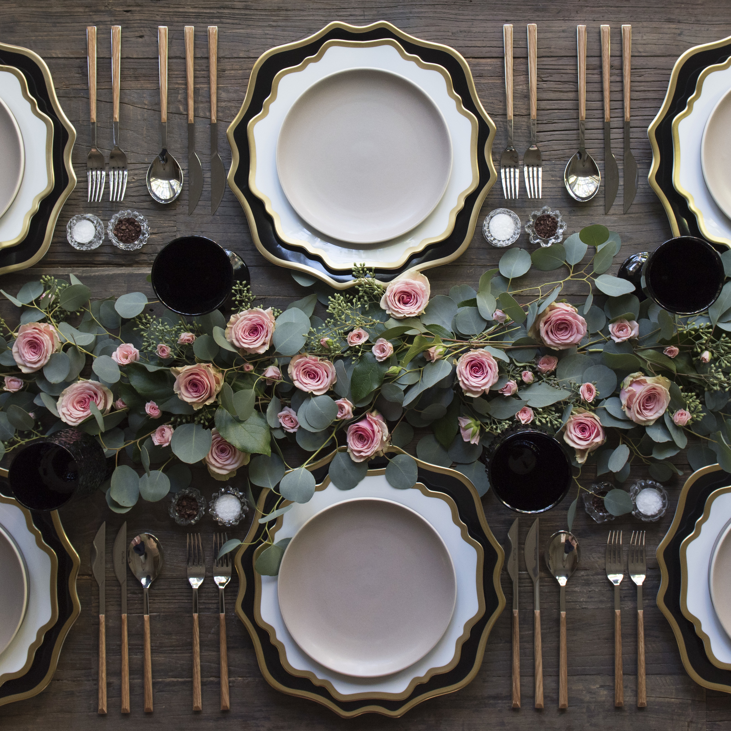 RENT: Anna Weatherley Chargers in Black/Gold + Anna Weatherley Dinnerware in White/Gold + Heath Ceramics in French Grey + Danish Flatware in Teak + Black Vintage Goblets + Antique Crystal Salt Cellars   SHOP: Anna Weatherley Dinnerware in White/Gold