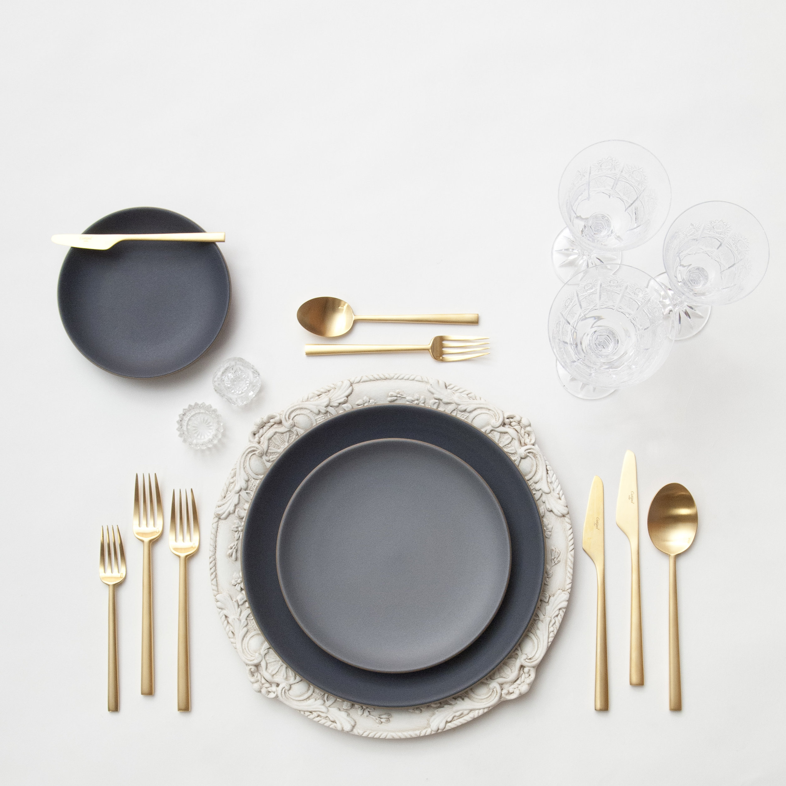 RENT: Verona Chargers in Antique White + Heath Ceramics in Indigo/Slate + Rondo Flatware in Brushed 24k Gold + Czech Crystal Stemware + Antique Crystal Salt Cellars   SHOP: Verona Chargers in Antique White + Rondo Flatware in Brushed 24k Gold