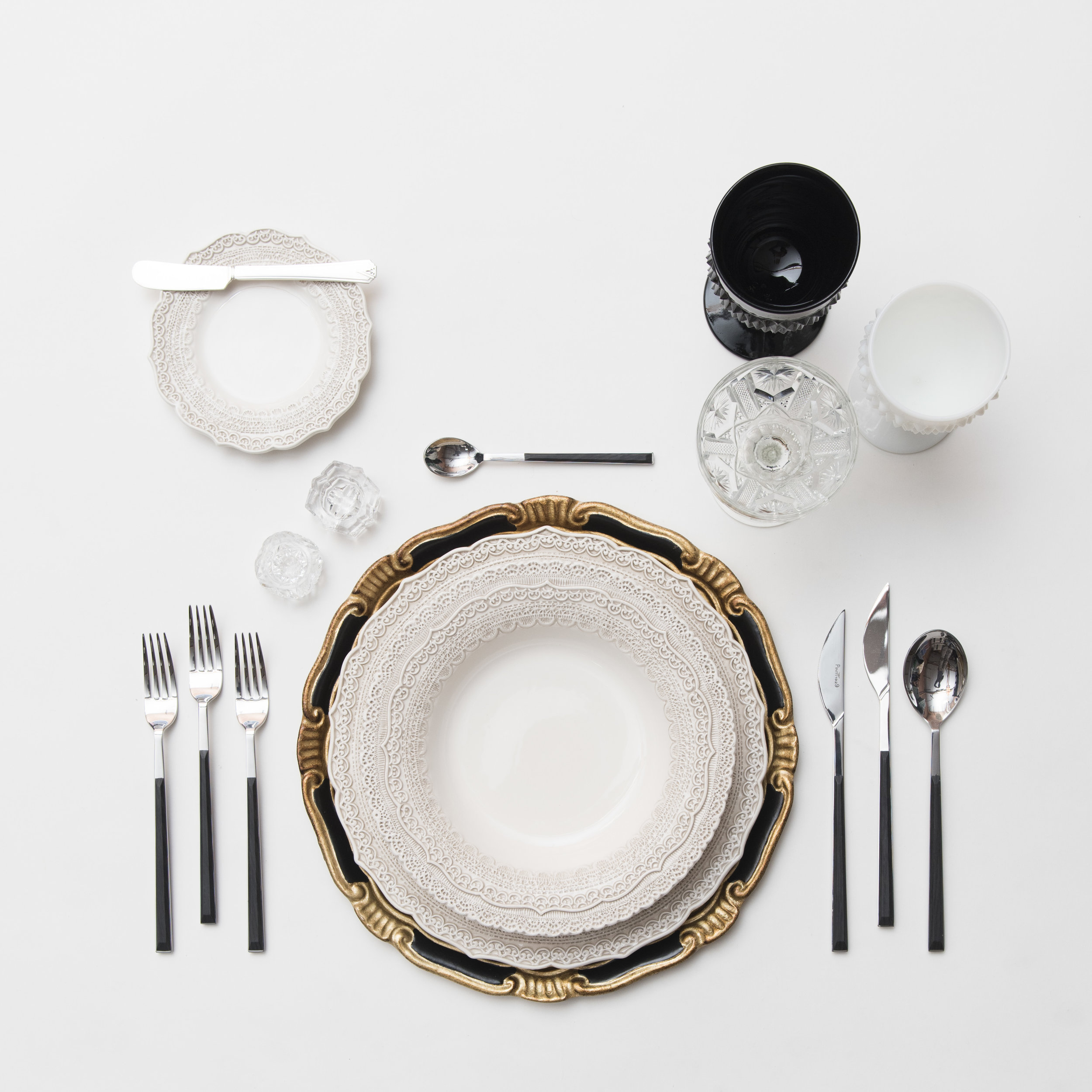 RENT: Florentine Chargers in Black/Gold + Lace Dinnerware in White + Danish Flatware in Ebony + Black/Milk Glass Vintage Goblets + Vintage Champagne Coupes + Antique Crystal Salt Cellars  SHOP: Florentine Chargers in Black/Gold