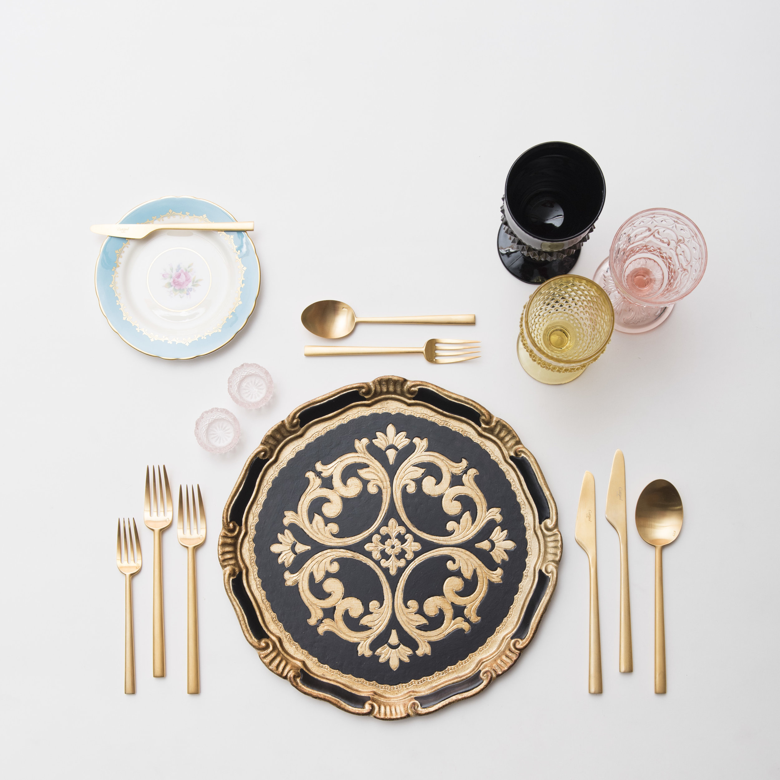 RENT: Florentine Chargers in Black/Gold + Blue Botanicals Vintage China + Rondo Flatware in Brushed 24k Gold + Black/Pink/Yellow Vintage Goblets + Pink Crystal Salt Cellars  SHOP: Florentine Chargers in Black/Gold + Rondo Flatware in Brushed 24k Gold