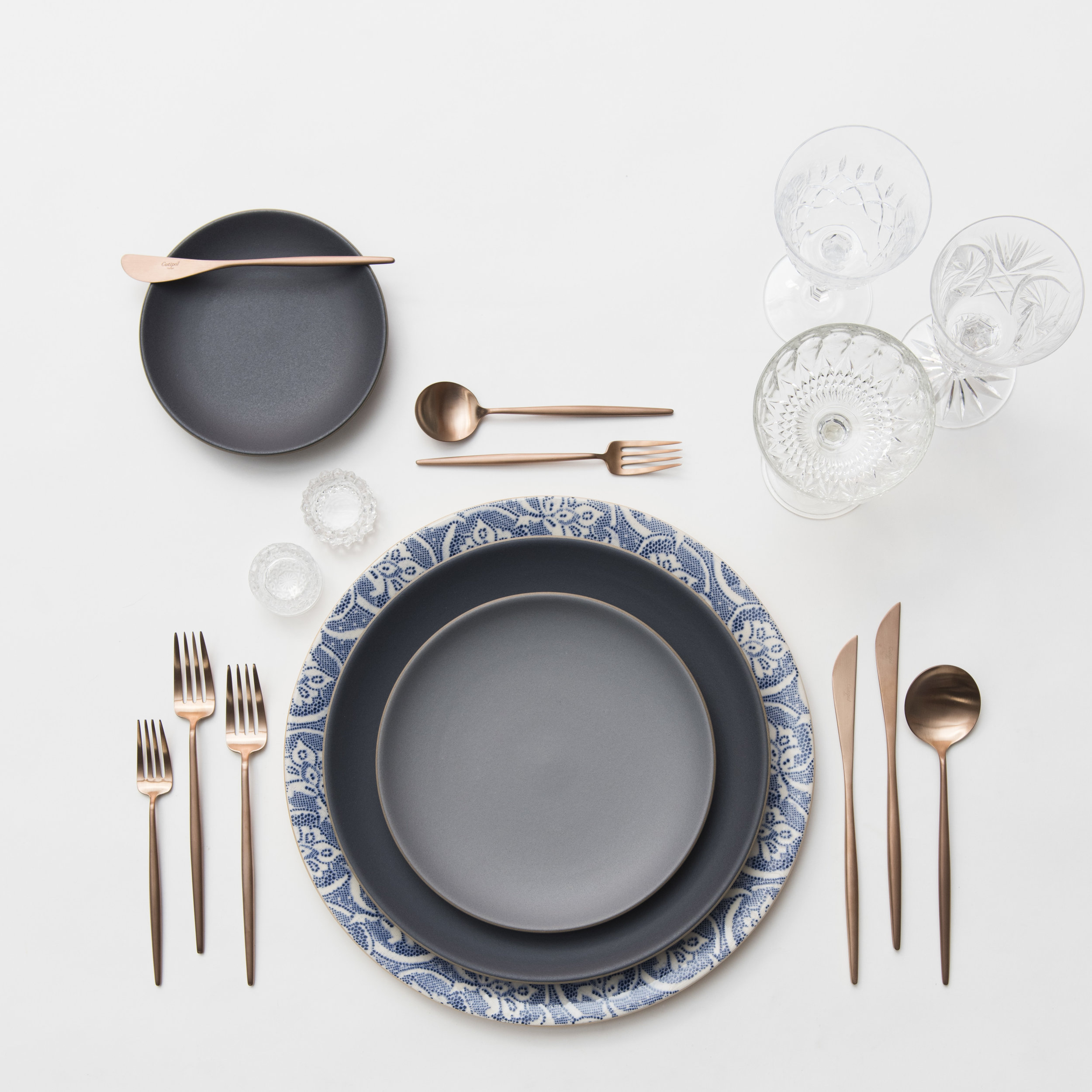 RENT: Blue Fleur de Lis Chargers + Heath Ceramics in Indigo/Slate + Moon Flatware in Brushed Rose Gold + Vintage Cut Crystal Goblets + Vintage Champagne Coupes + Antique Crystal Salt Cellars   SHOP: Moon Flatware in Brushed Rose Gold