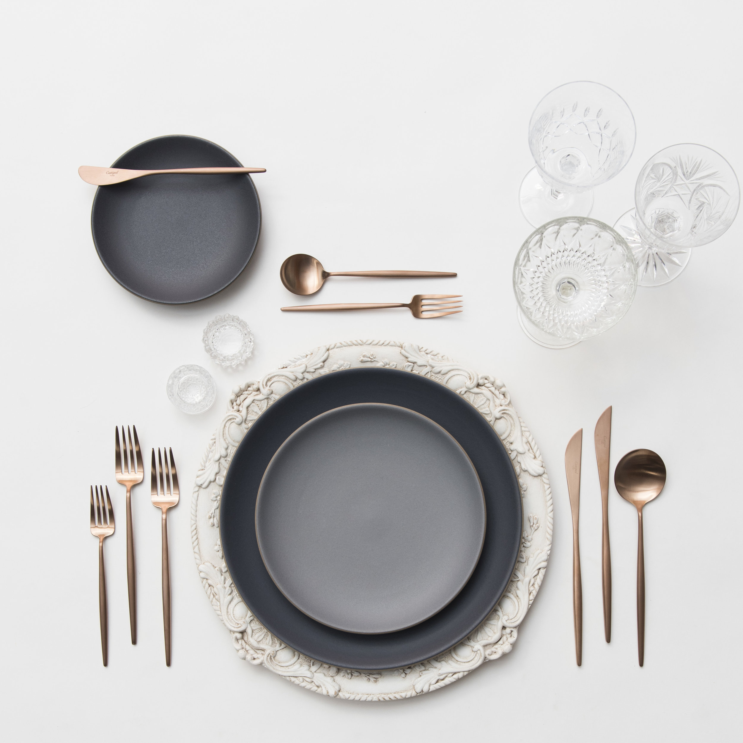 RENT: Verona Chargers in Antique White + Heath Ceramics in Indigo/Slate + Moon Flatware in Brushed Rose Gold + Vintage Cut Crystal Goblets + Vintage Champagne Coupes + Antique Crystal Salt Cellars   SHOP: Verona Chargers in Antique White + Moon Flatware in Brushed Rose Gold