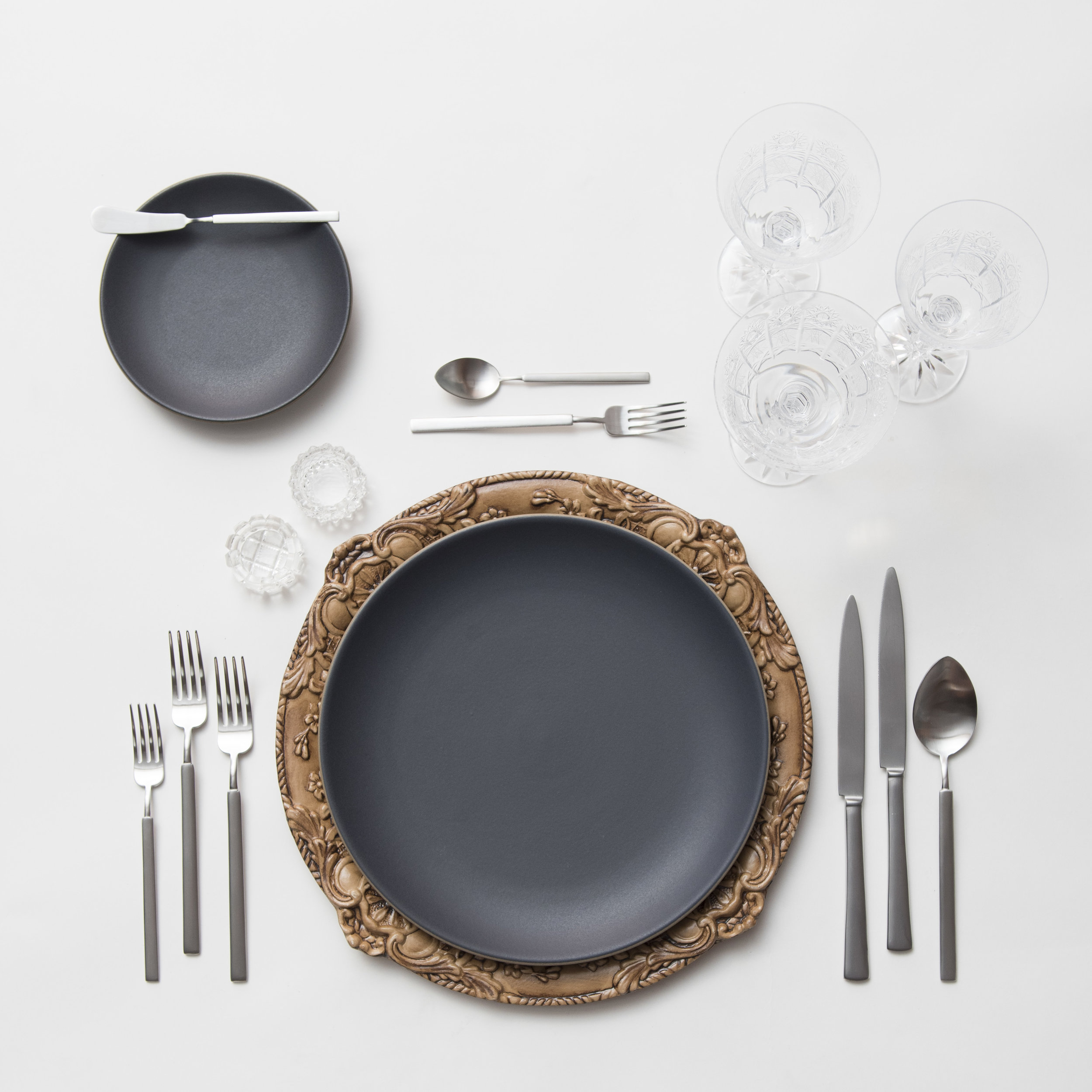 RENT: Verona Chargers in Walnut + Heath Ceramics in Indigo/Slate + Axel Flatware in Matte Silver + Czech Crystal Stemware + Antique Crystal Salt Cellars  SHOP: Verona Chargers in Walnut
