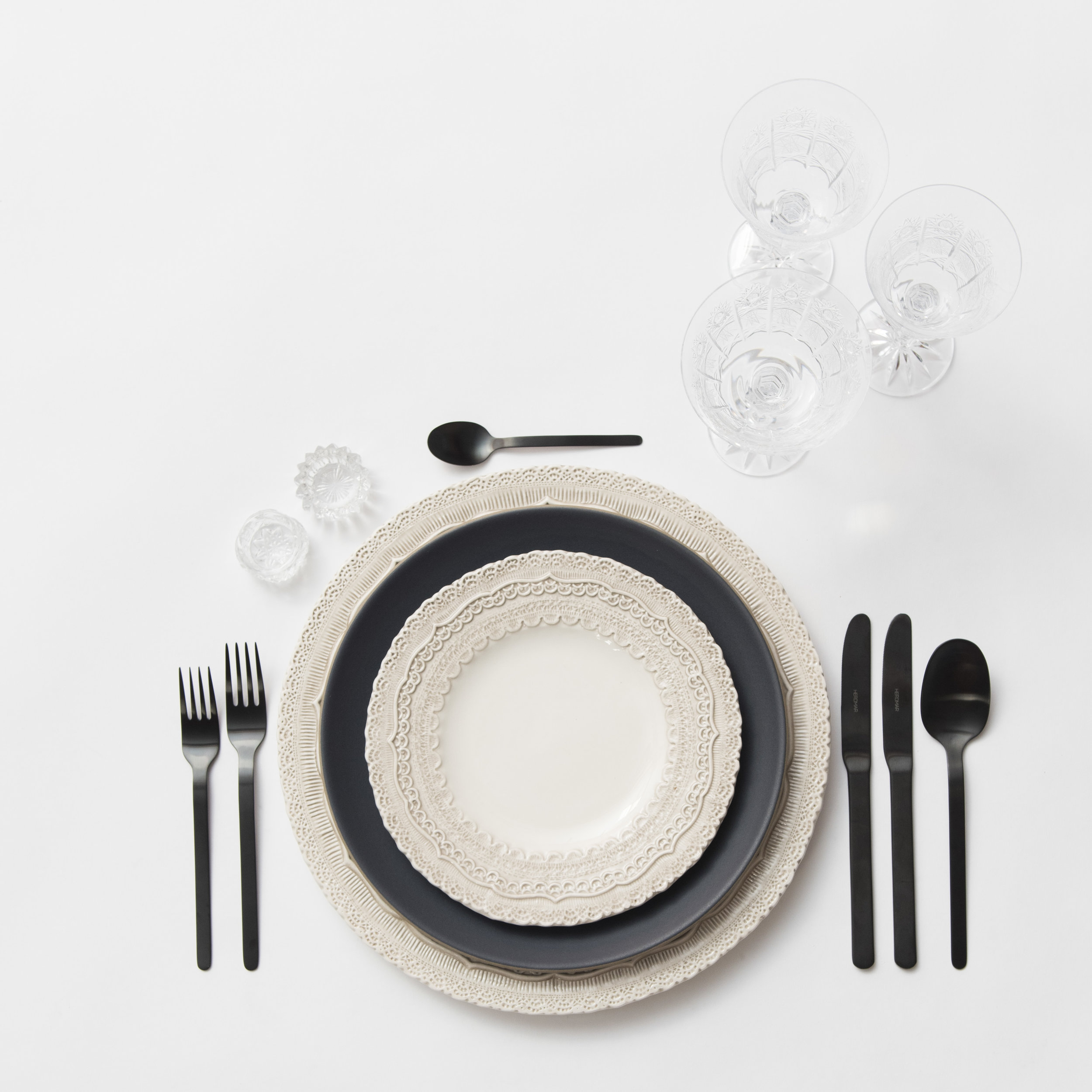RENT: Lace Chargers/Dinnerware in White + Heath Ceramics in Indigo/Slate + Finn Flatware in Matte Black + Czech Crystal Stemware + Antique Crystal Salt Cellars