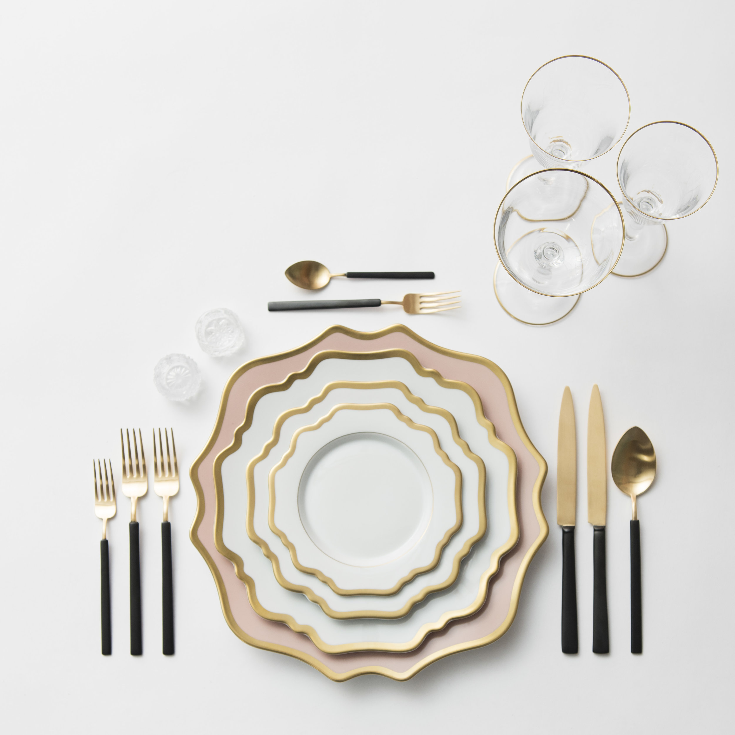 RENT: Anna Weatherley Chargers in Desert Rose/Gold + Anna Weatherley Dinnerware in White/Gold + Axel Flatware in Matte 24k Gold/Black + Chloe 24k Gold Rimmed Stemware + Antique Crystal Salt Cellars  SHOP: Anna Weatherley Dinnerware in White/Gold + Chloe 24k Gold Rimmed Stemware