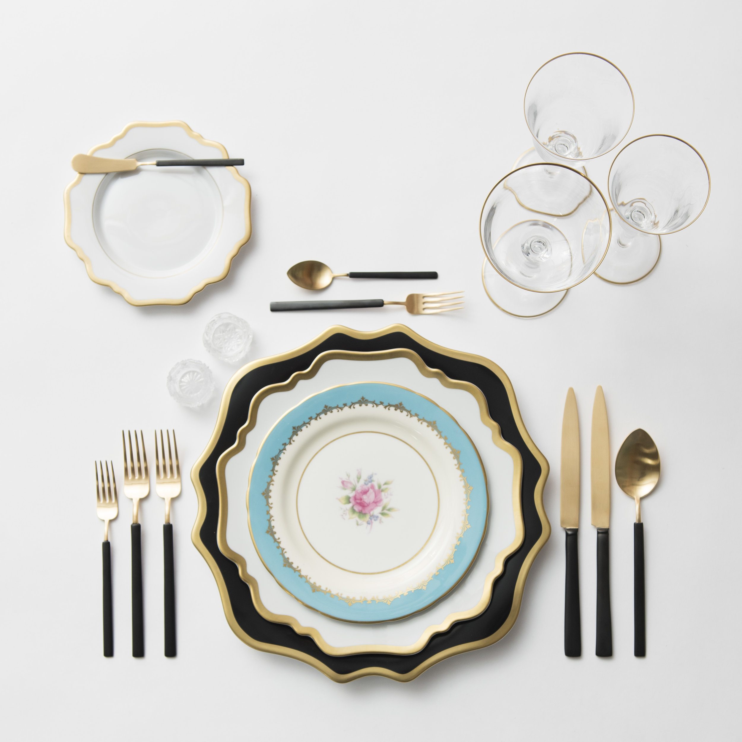 RENT: Anna Weatherley Chargers in Black/Gold + Anna Weatherley Dinnerware in White/Gold + Blue Botanicals Vintage China + Axel Flatware in Matte 24k Gold/Black + Chloe 24k Gold Rimmed Stemware + Antique Crystal Salt Cellars  SHOP: Anna Weatherley Dinnerware in White/Gold + Chloe 24k Gold Rimmed Stemware