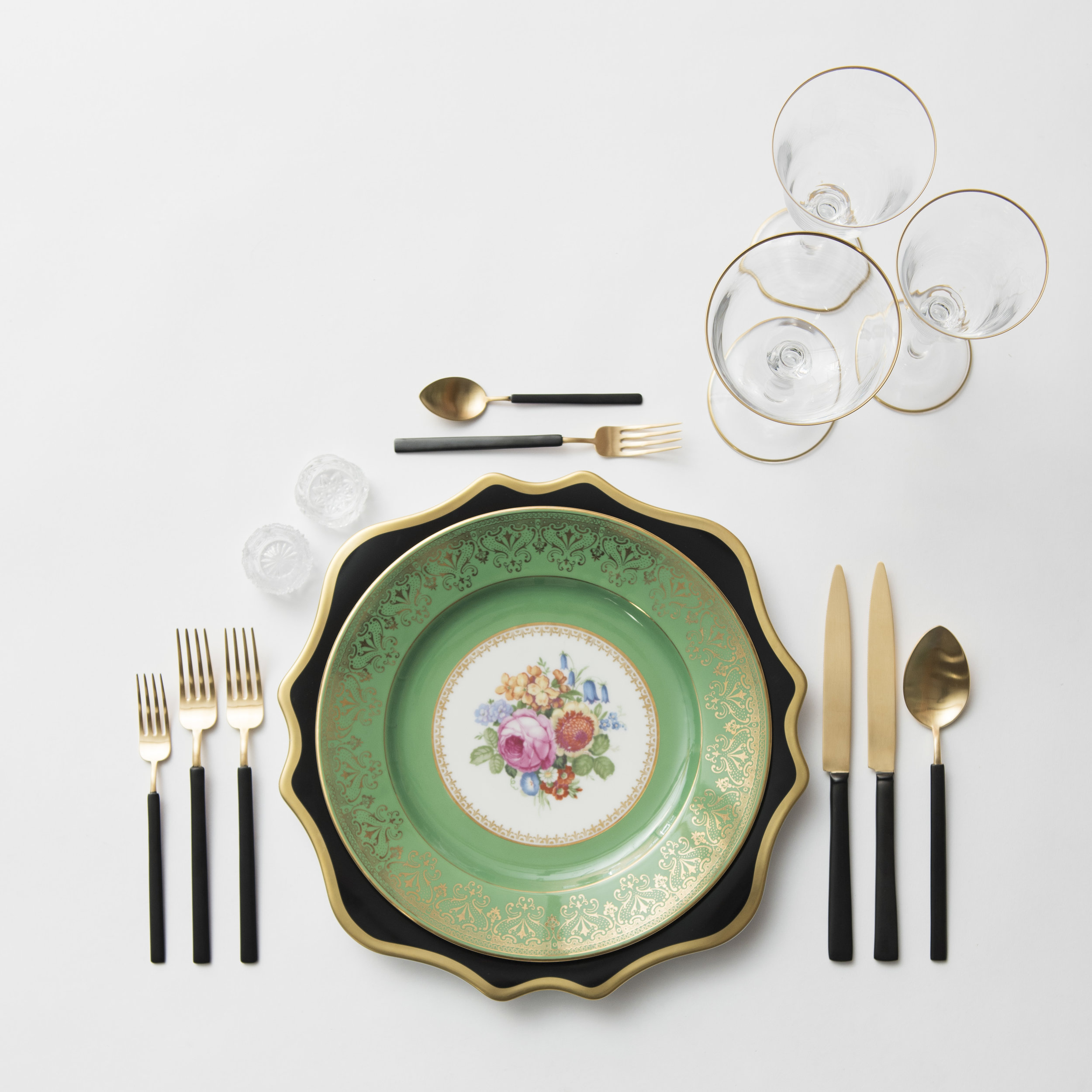 RENT: Anna Weatherley Chargers in Black/Gold + Green Botanicals Vintage China + Axel Flatware in Matte 24k Gold/Black + Chloe 24k Gold Rimmed Stemware + Antique Crystal Salt Cellars  SHOP: Chloe 24k Gold Rimmed Stemware