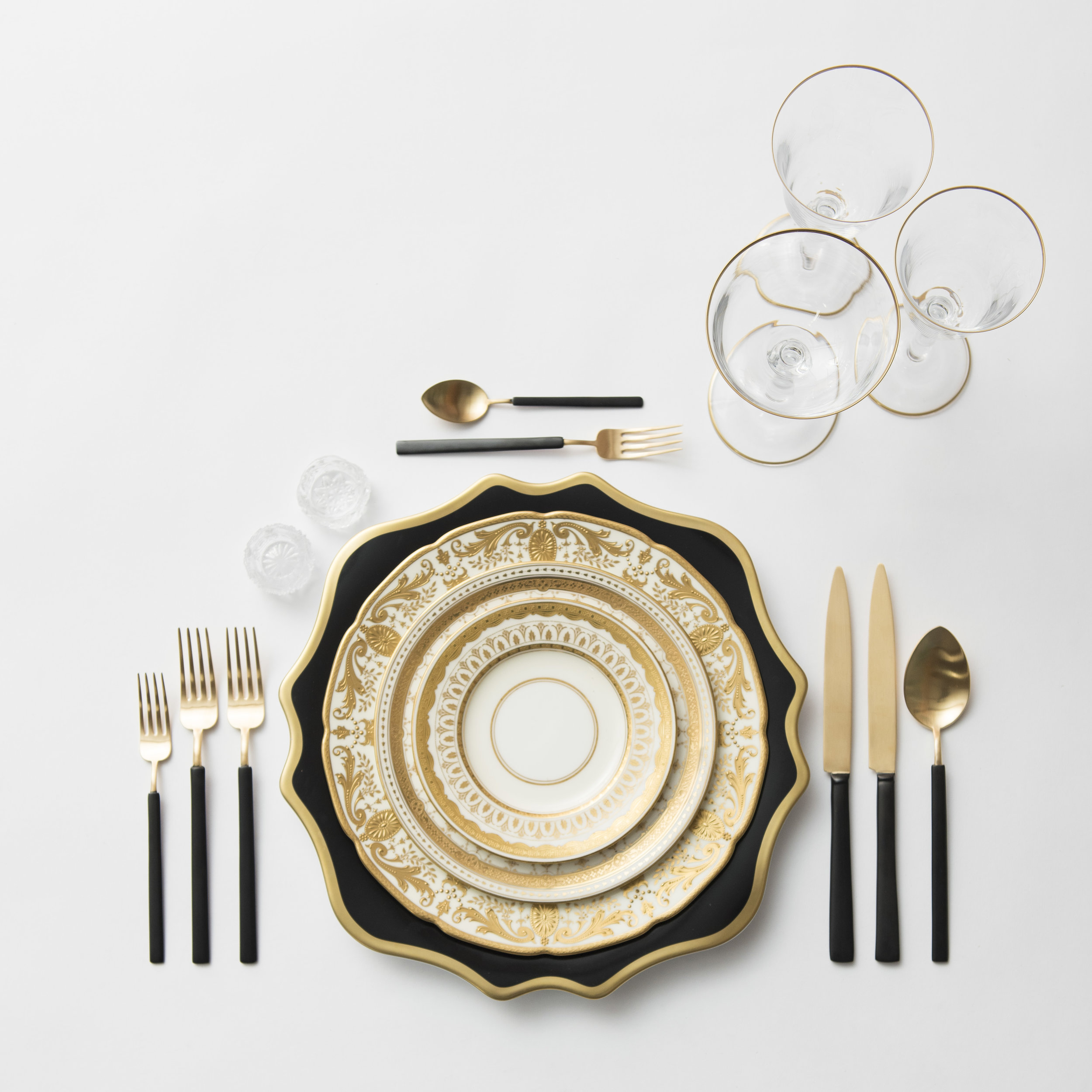 RENT: Anna Weatherley Chargers in Black/Gold + Crown Gold Collection Vintage China + Axel Flatware in Matte 24k Gold/Black + Chloe 24k Gold Rimmed Stemware + Antique Crystal Salt Cellars  SHOP: Chloe 24k Gold Rimmed Stemware
