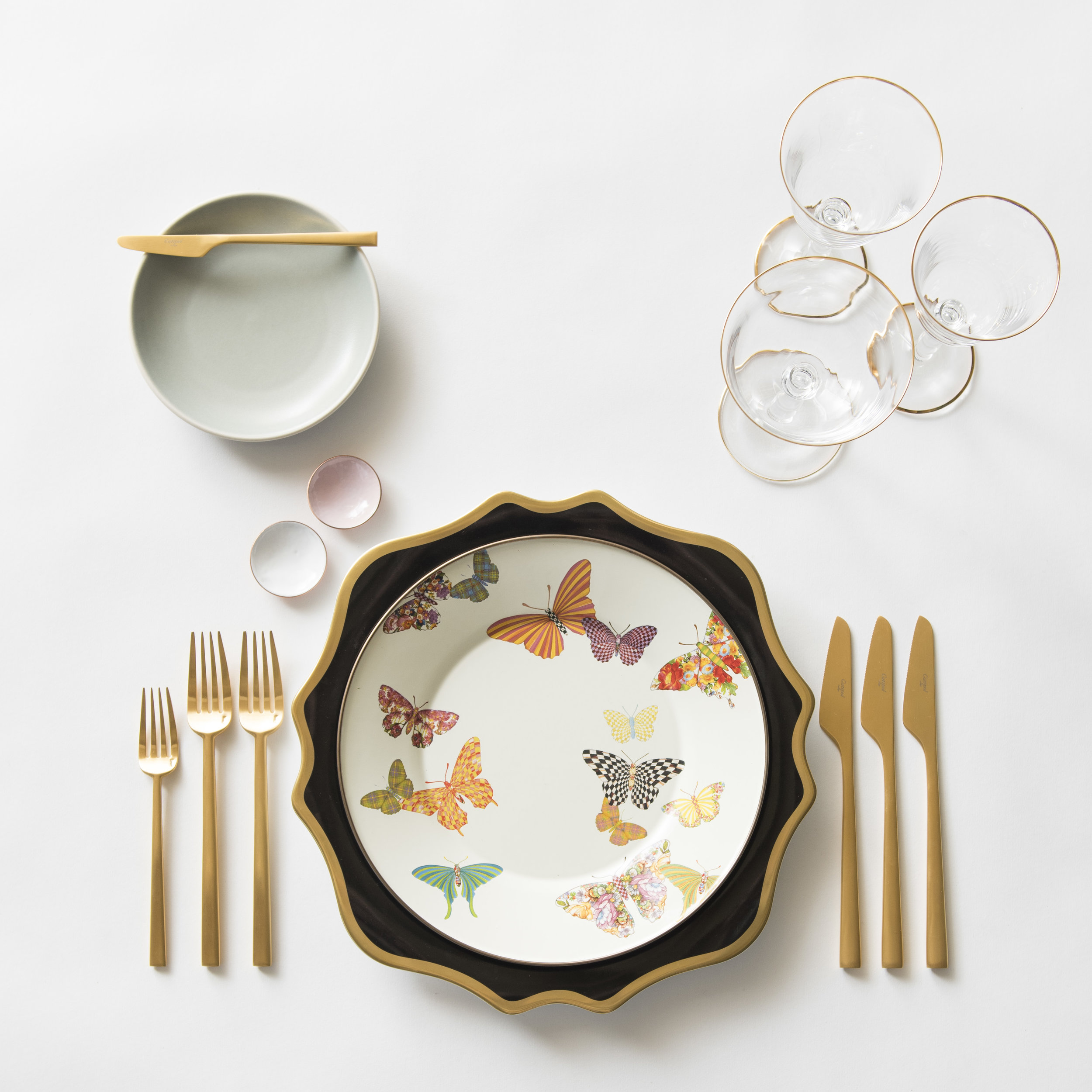 RENT: Anna Weatherley Chargers in Black/Gold + MacKenzie-Childs Butterfly Garden Collection + Heath Ceramics in Mist + Rondo Flatware in Brushed 24k Gold + Chloe 24k Gold Rimmed Stemware + White/Pink Enamel Salt Cellars   SHOP: Rondo Flatware in Brushed 24k Gold + Chloe 24k Gold Rimmed Stemware