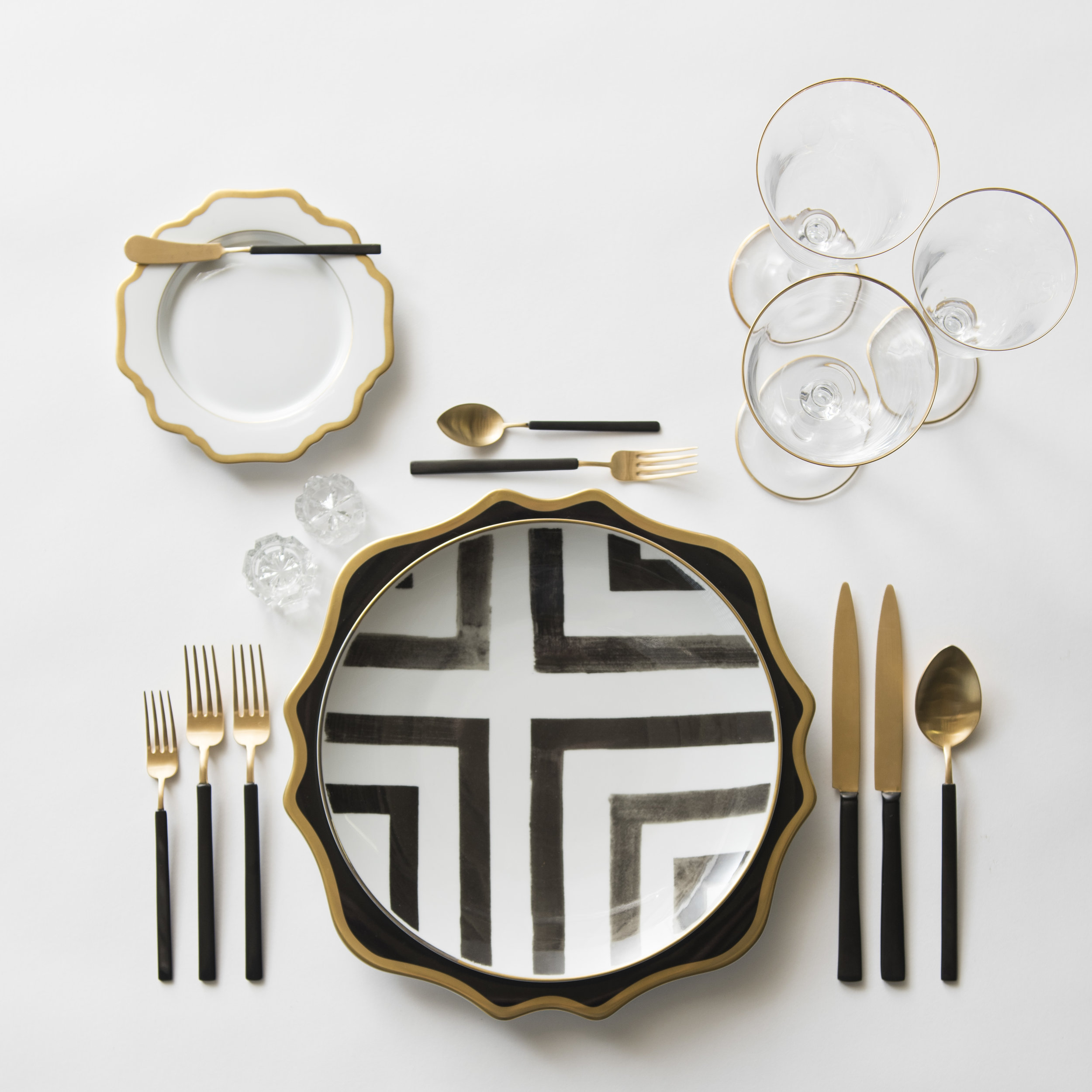 RENT: Anna Weatherley Chargers in Black/Gold + Anna Weatherley Dinnerware in White/Gold + Christian Lacroix Sol Y Sombra Dinnerware + Axel Flatware in Matte 24k Gold/Black + Chloe 24k Gold Rimmed Stemware + Antique Crystal Salt Cellars  SHOP: Anna Weatherley Dinnerware in White/Gold + Christian Lacroix Sol Y Sombra Dinnerware + Chloe 24k Gold Rimmed