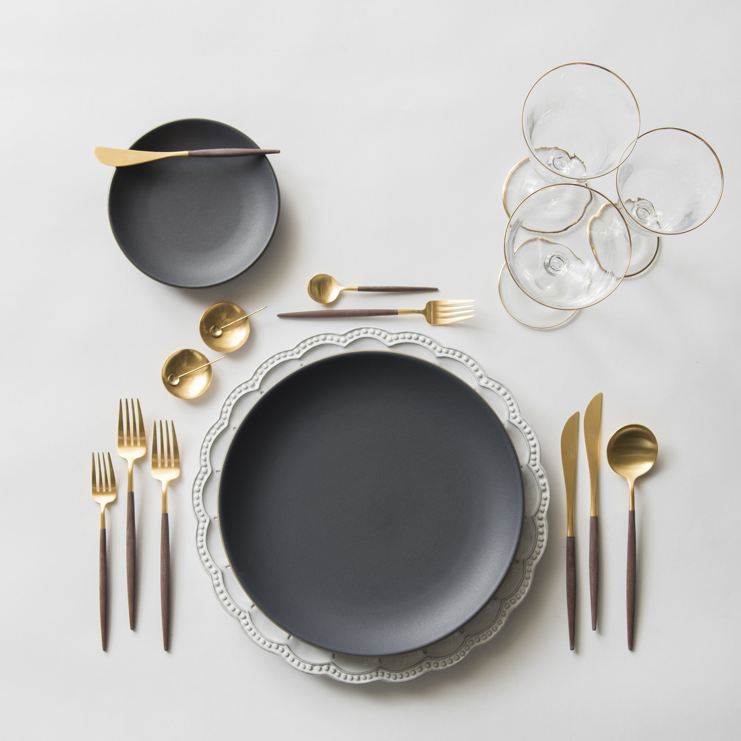 RENT: Signature Collection Chargers + Heath Ceramics in Indigo/Slate + Goa Flatware in Brushed 24k Gold/Wood + Chloe 24k Gold Rimmed Stemware + 14k Gold Salt Cellars + Tiny Gold Spoons  SHOP: Goa Flatware in Brushed 24k Gold/Wood + Chloe 24k Gold Rimmed Stemware + 14k Gold Salt Cellars + Tiny Gold Spoons