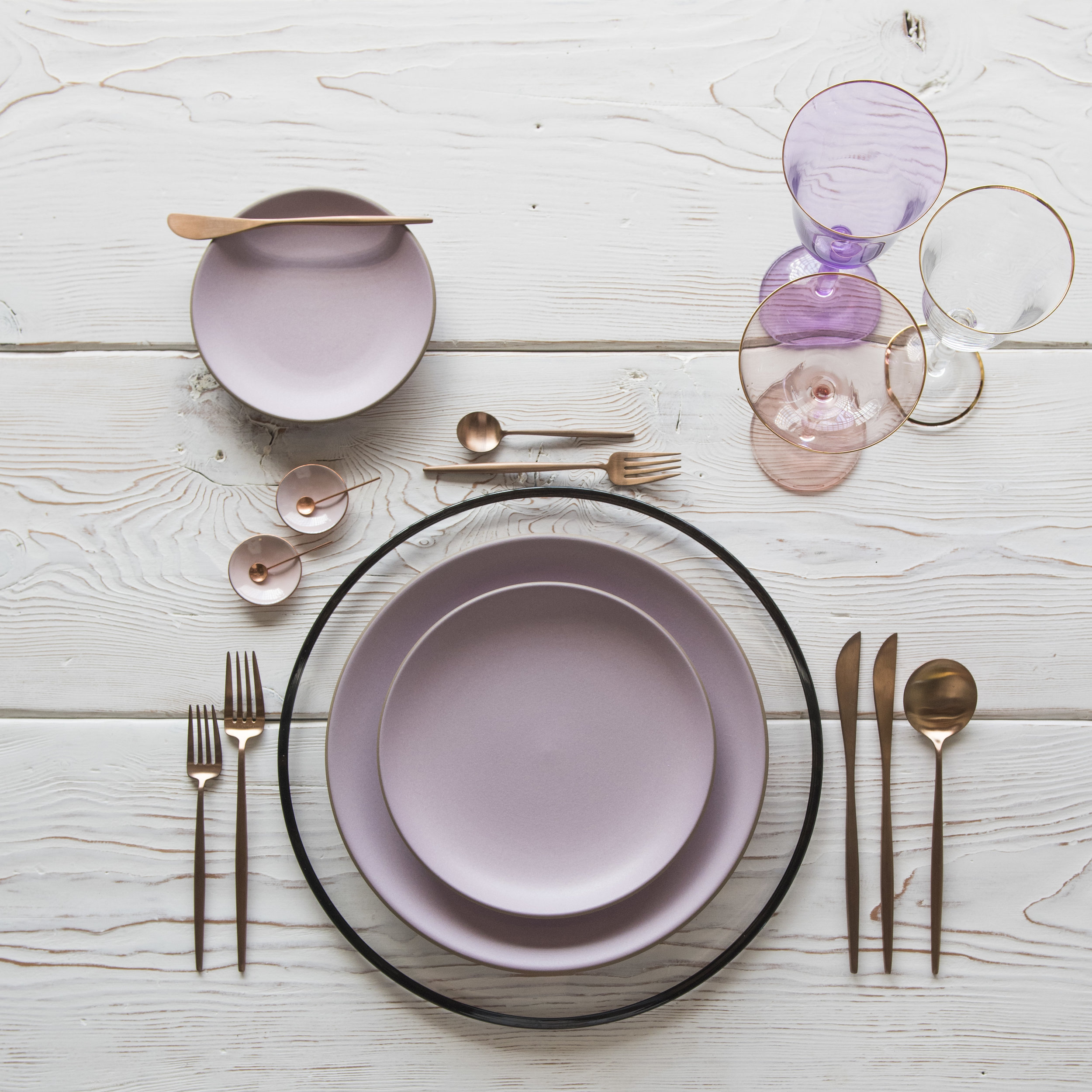 RENT: Halo Glass Chargers in Black + Custom Heath Ceramics in Wildflower + Moon Flatware in Brushed Rose Gold + Chloe 24k Gold Rimmed Stemware + Chloe 24k Gold Rimmed Goblet in Lilac + Bella 24k Gold Rimmed Stemware in Blush + Pink Enamel Salt Cellars + Tiny Copper Spoons  SHOP: Halo Glass Chargers in Black + Moon Flatware in Brushed Rose Gold + Chloe 24k Gold Rimmed Stemware + Bella 24k Gold Rimmed Stemware in Blush + Pink Enamel Salt Cellars + Tiny Copper Spoons