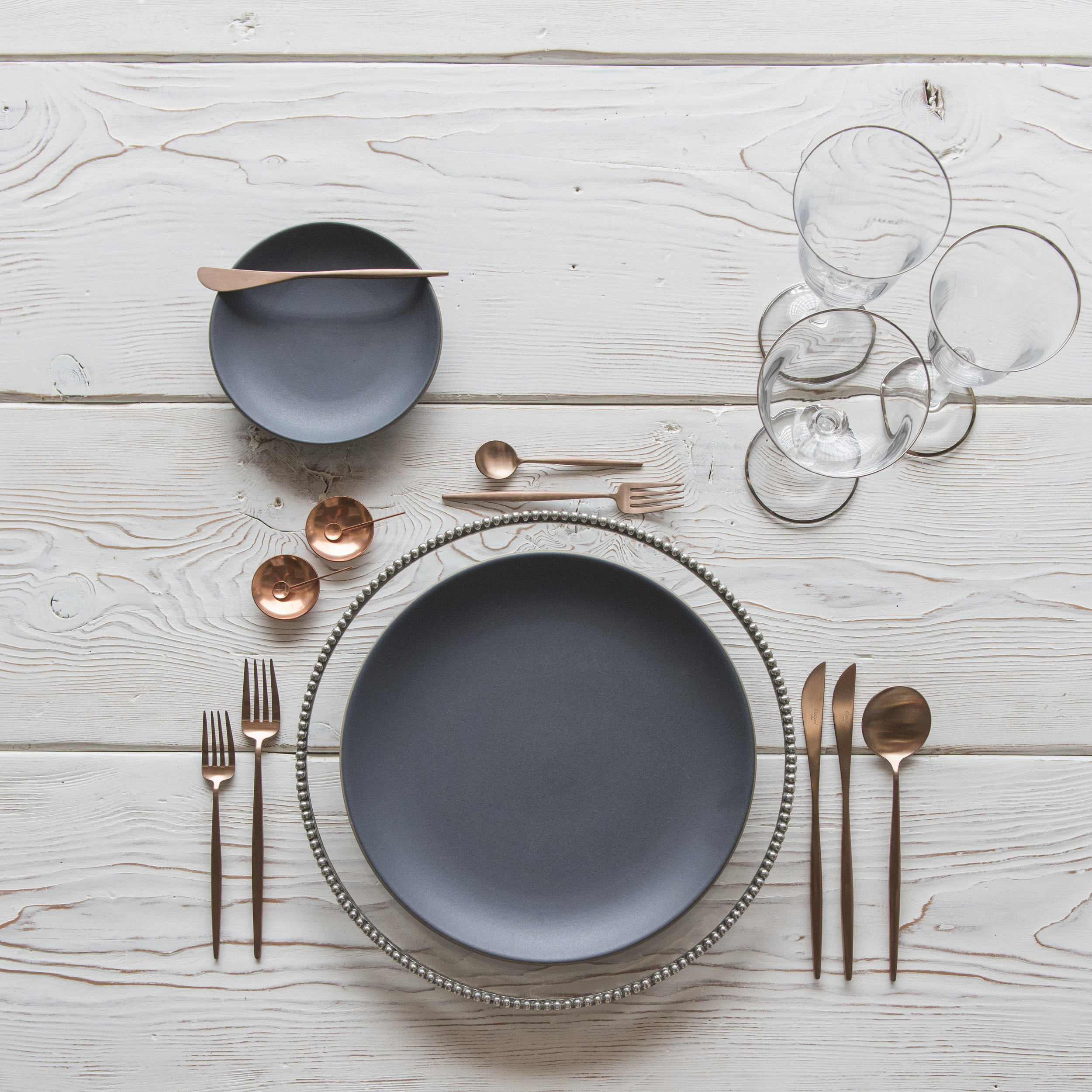 RENT: Halo Glass Chargers in Platinum + Heath Ceramics in Indigo/Slate + Moon Flatware in Brushed Rose Gold + Chloe Platinum Rimmed Stemware + Copper Salt Cellars + Tiny Copper Spoons   SHOP: Halo Glass Chargers in Platinum + Moon Flatware in Brushed Rose Gold + Chloe Platinum Rimmed Stemware + Copper Salt Cellars + Tiny Copper Spoons