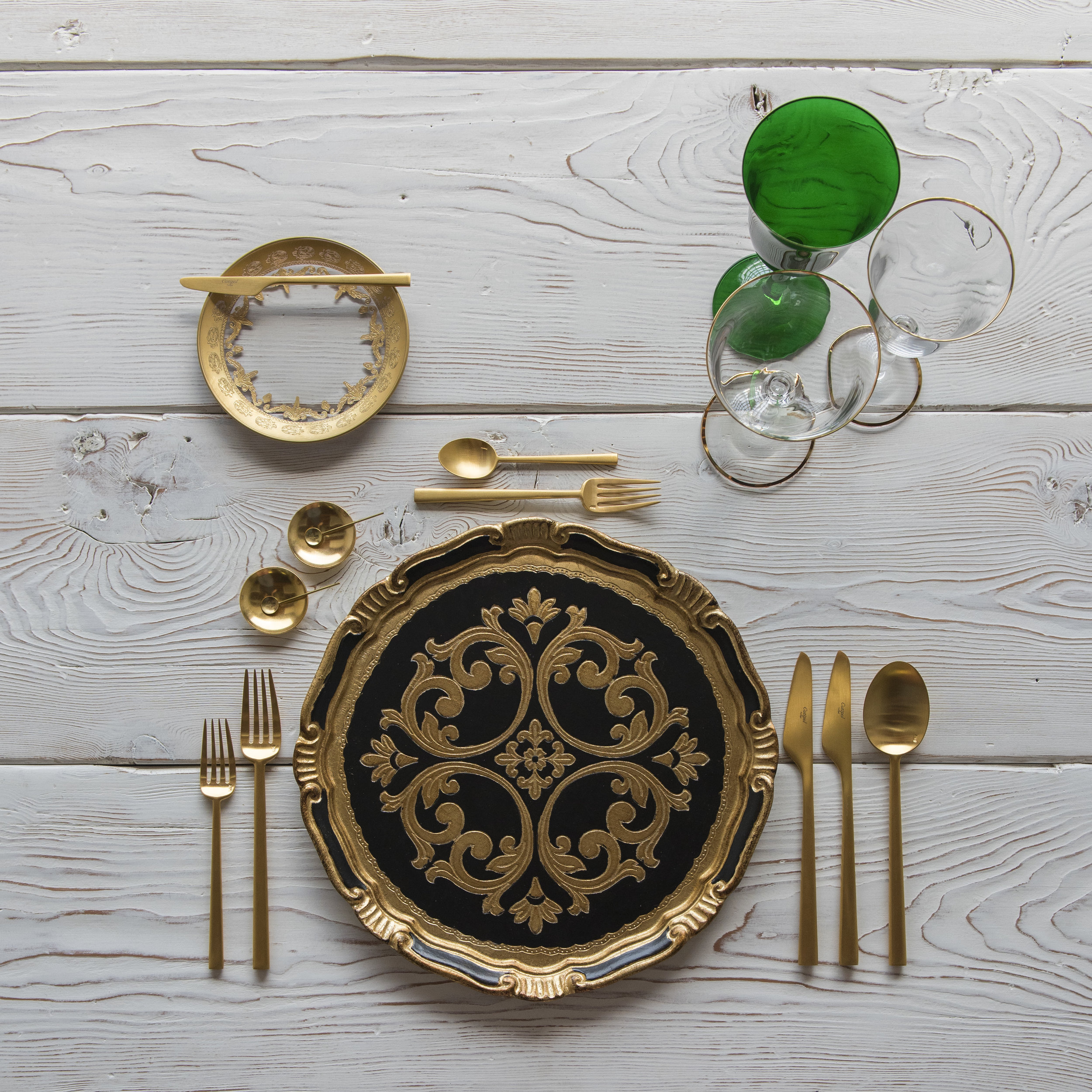RENT: Florentine Chargers in Black/Gold + Versailles Glass Dinnerware in 24k Gold + Rondo Flatware in Brushed 24k Gold + Chloe 24k Gold Rimmed Stemware + Chloe 24k Gold Rimmed Goblet in Emerald + 14k Gold Salt Cellars + Tiny Gold Spoons   SHOP: Florentine Chargers in Black/Gold + Rondo Flatware in Brushed 24k Gold + Chloe 24k Gold Rimmed Stemware + 14k Gold Salt Cellars + Tiny Gold Spoons