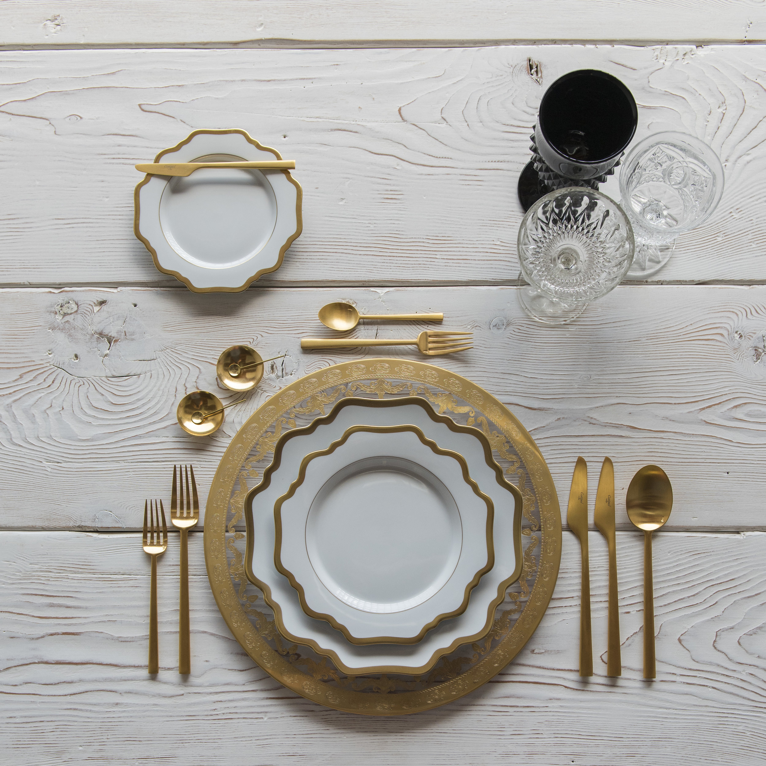 RENT: Versailles Glass Chargers in 24k Gold + Anna Weatherley Dinnerware in White/Gold + Rondo Flatware in Brushed 24k Gold + Black Vintage Goblets + Early American Pressed Glass Goblets + Vintage Champagne Coupes + 14k Gold Salt Cellars + Tiny Gold Spoons   SHOP: Anna Weatherley Dinnerware in White/Gold + Rondo Flatware in Brushed 24k Gold + 14k Gold Salt Cellars + Tiny Gold Spoons