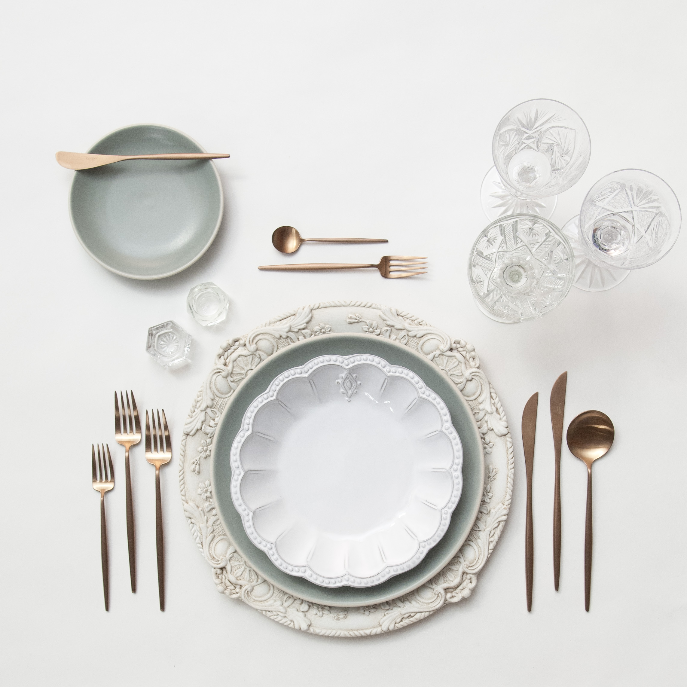 RENT: Verona Chargers in Antique White + Heath Ceramics in Mist + Signature Collection Dinnerware + Moon Flatware in Brushed Rose Gold + Vintage Cut Crystal Goblets + Vintage Champagne Coupes + Antique Crystal Salt Cellars  SHOP: Moon Flatware in Brushed Rose Gold
