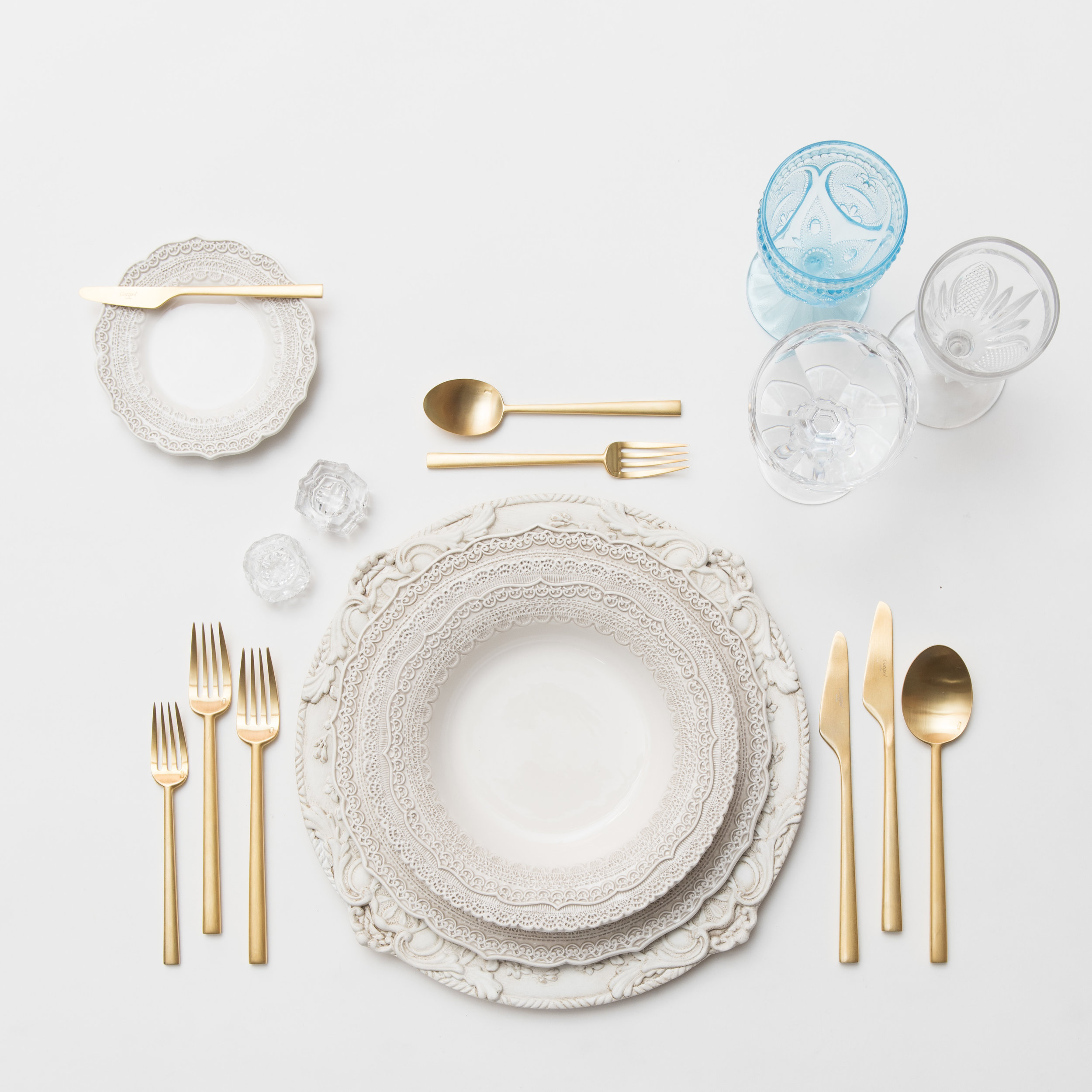RENT: Verona Chargers in Antique White + Lace Dinnerware in White + Rondo Flatware in Brushed 24k Gold + Aqua Vintage Goblets + Early American Pressed Glass Goblets + Vintage Champagne Coupes + Antique Crystal Salt Cellars  SHOP:Verona Chargers in Antique White +Rondo Flatware in Brushed 24k Gold