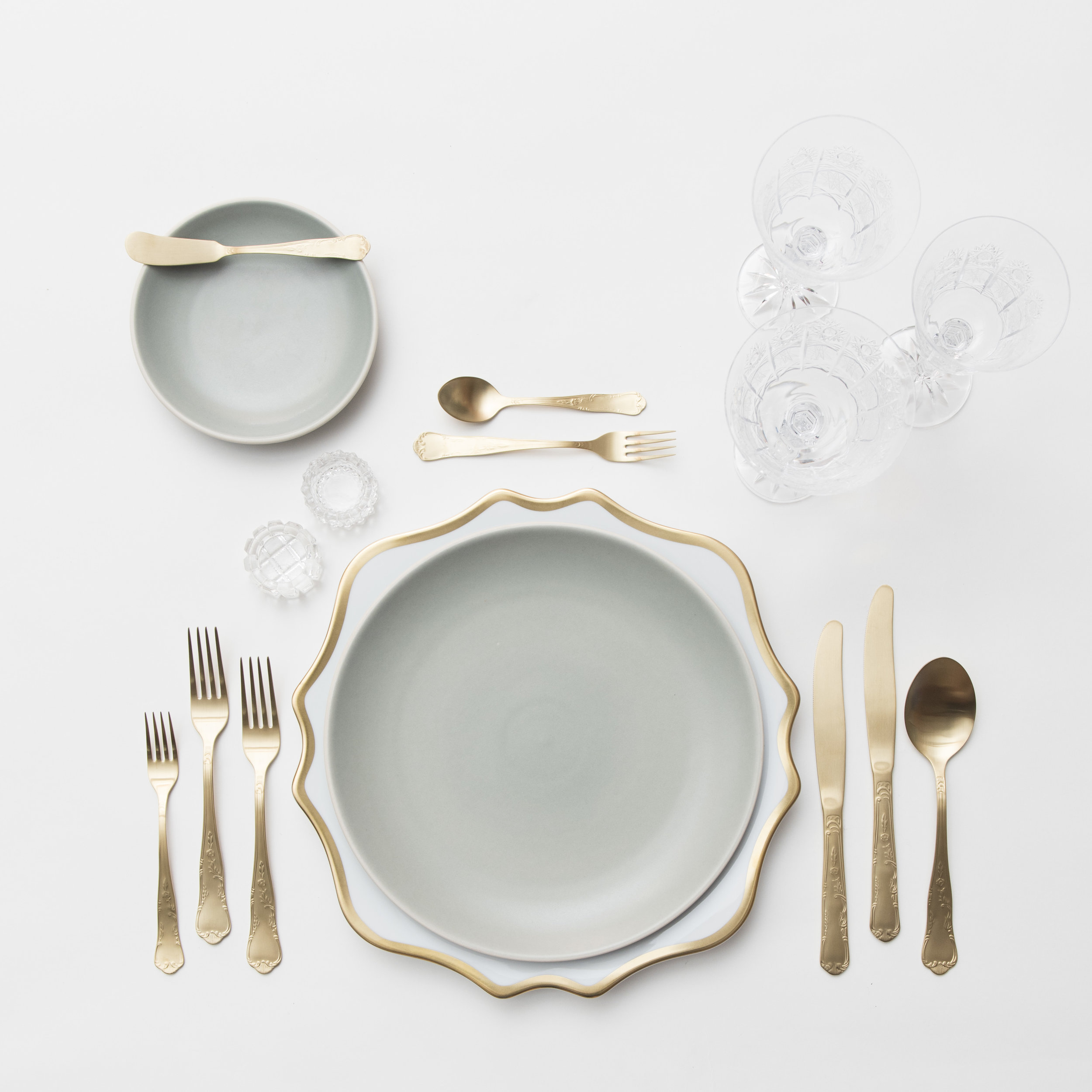RENT: Anna Weatherley Chargers in White/Gold + Heath Ceramics in Mist + Chateau Flatware in Matte Gold + Czech Crystal Stemware + Antique Crystal Salt Cellars  SHOP:Anna Weatherley Chargers in White/Gold