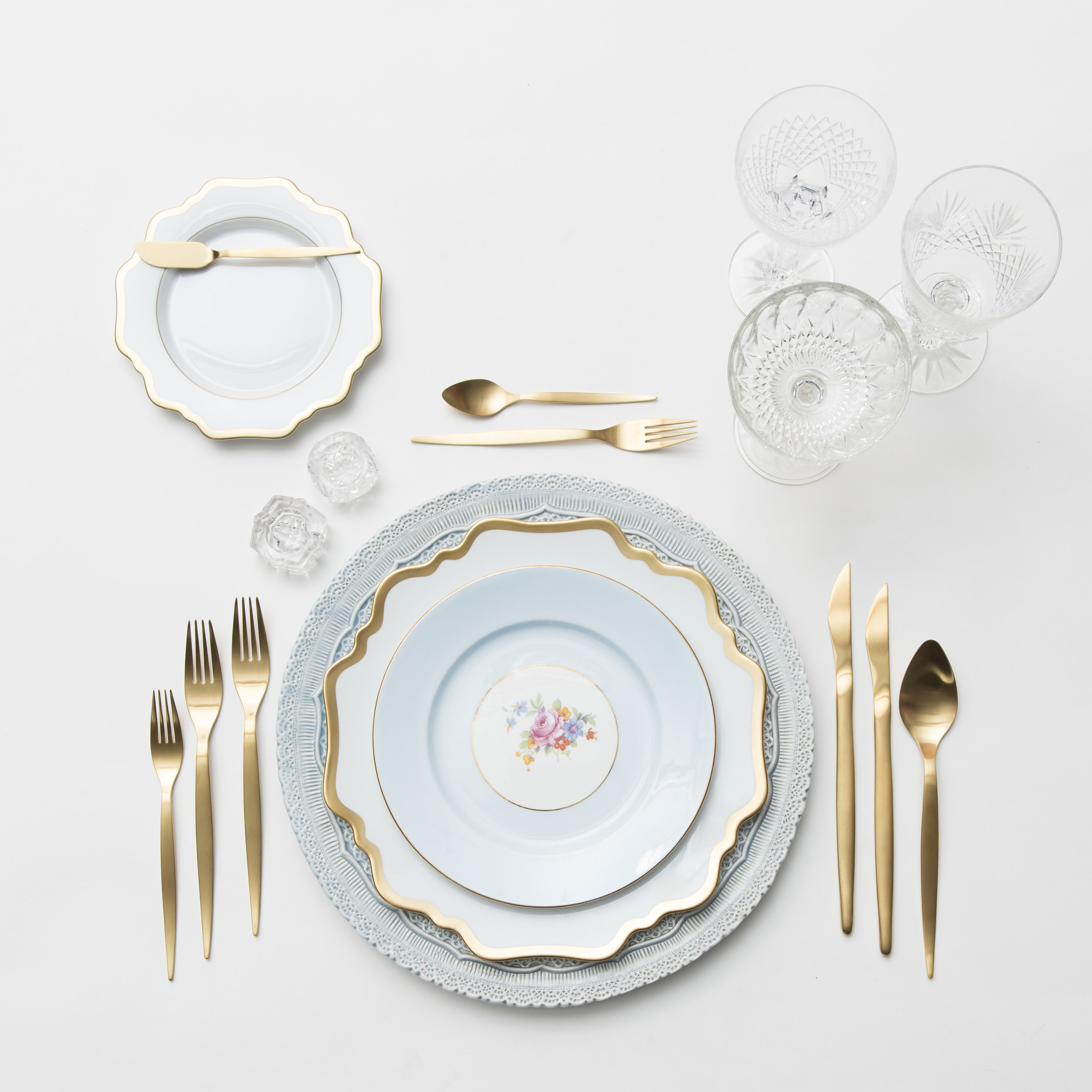 RENT: Lace Chargers in Dusty Blue + Anna Weatherley Dinnerware in White/Gold + Blue Botanicals Vintage China + Celeste Flatware in Matte Gold + Vintage Cut Crystal Goblets +Vintage Champagne Coupes + Antique Crystal Salt Cellars  SHOP:Anna Weatherley Dinnerware in White/Gold