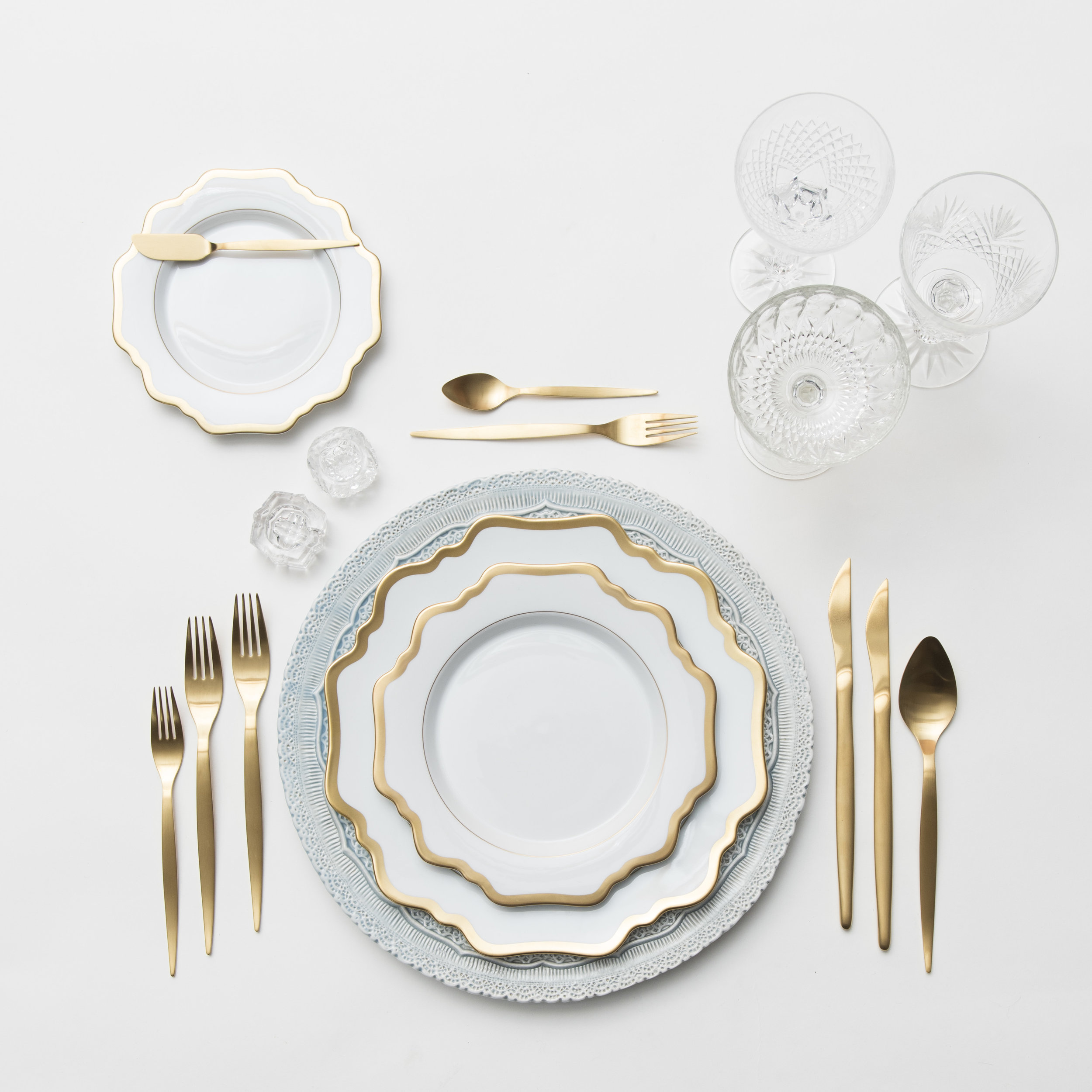 RENT: Lace Chargers in Dusty Blue + Anna Weatherley Dinnerware in White/Gold +Celeste Flatware in Matte Gold + Vintage Cut Crystal Goblets + Vintage Champagne Coupes + Antique Crystal Salt Cellars  SHOP:Anna Weatherley Dinnerware in White/Gold