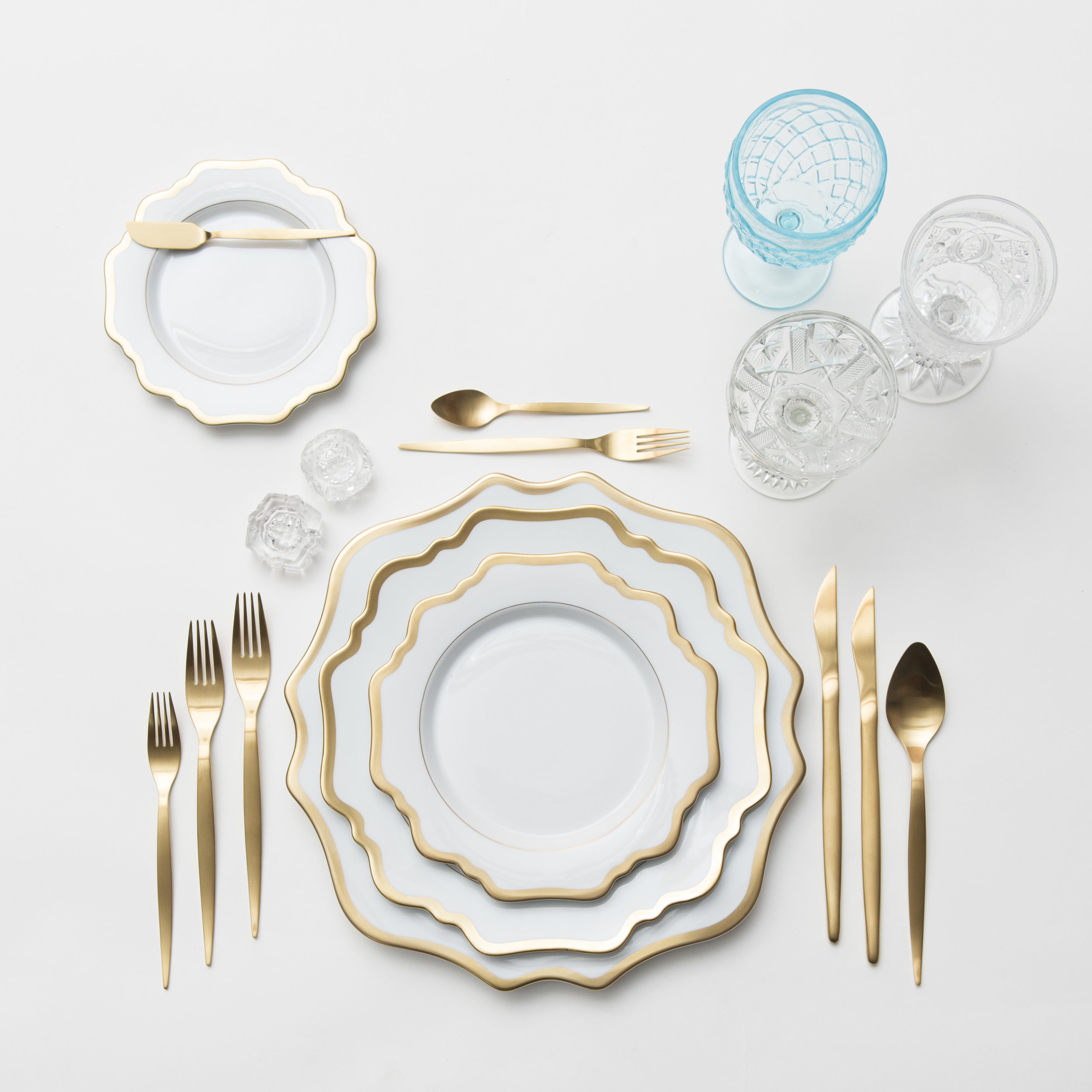 RENT: Anna Weatherley Chargers/Dinnerware in White/Gold + Celeste Flatware in Matte Gold + Aqua Vintage Goblets + Early American Pressed Glass Goblets + Vintage Champagne Coupes + Antique Crystal Salt Cellars  SHOP:Anna Weatherley Dinnerware in White/Gold