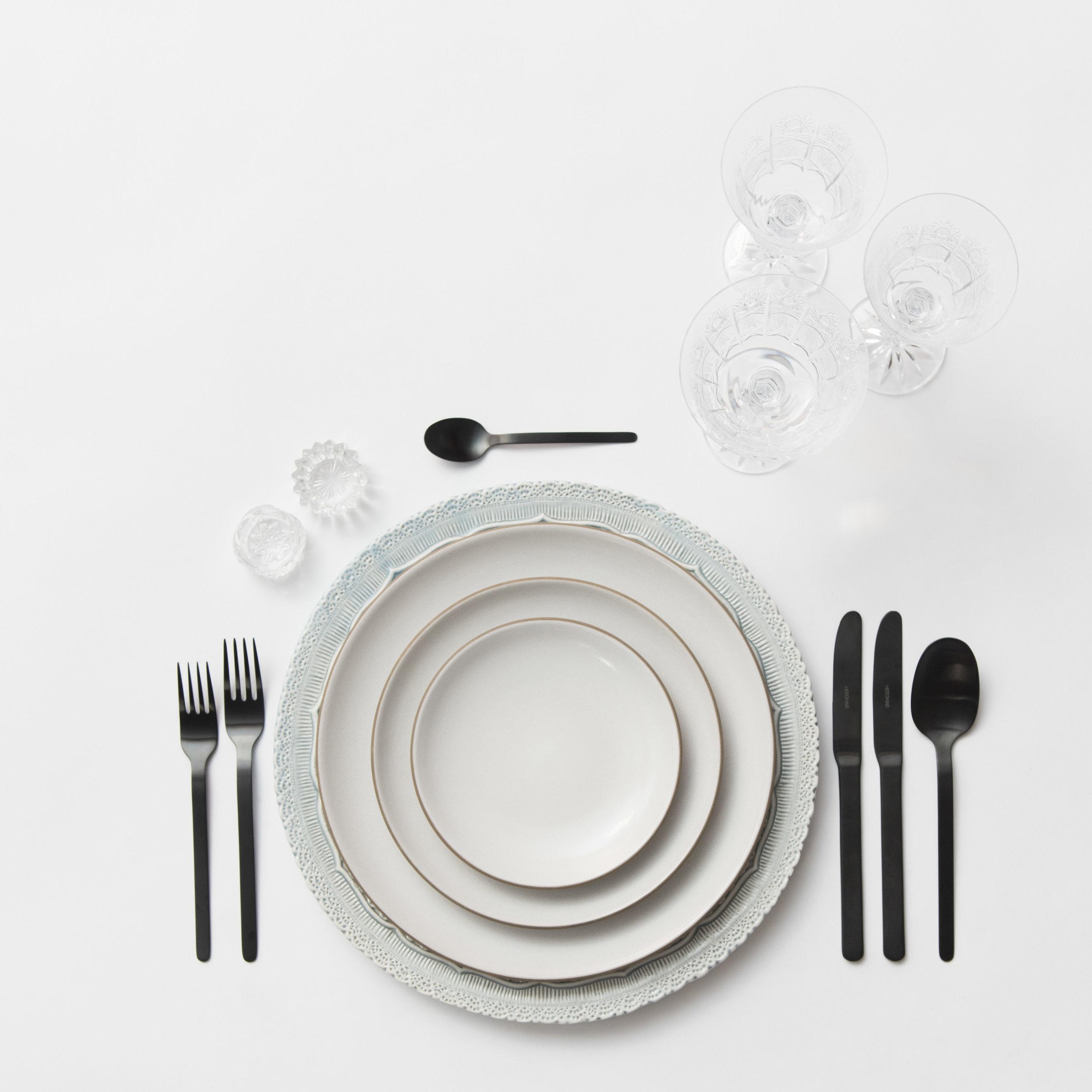 RENT: Lace Chargers in Dusty Blue + Heath Ceramics in Opaque White + Finn Flatware in Matte Black + Czech Crystal Stemware + Antique Crystal Salt Cellars