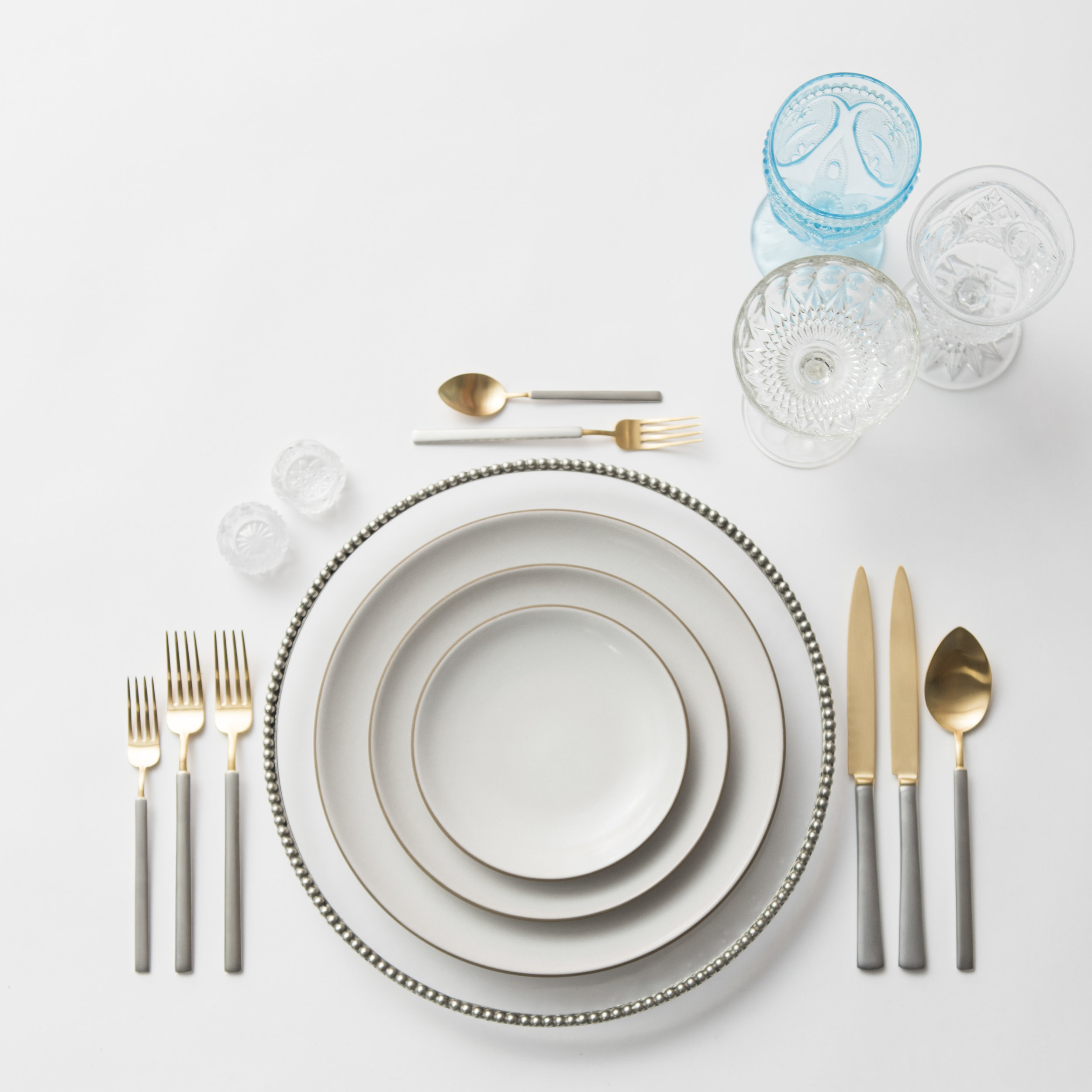 RENT: Pav é Glass Chargers in Pewter + Heath Ceramics in Opaque White + Axel Flatware in Matte 24k Gold/Silver + Aqua Vintage Goblets + Early American Pressed Glass Goblets + Vintage Champagne Coupes + Antique Crystal Salt Cellars