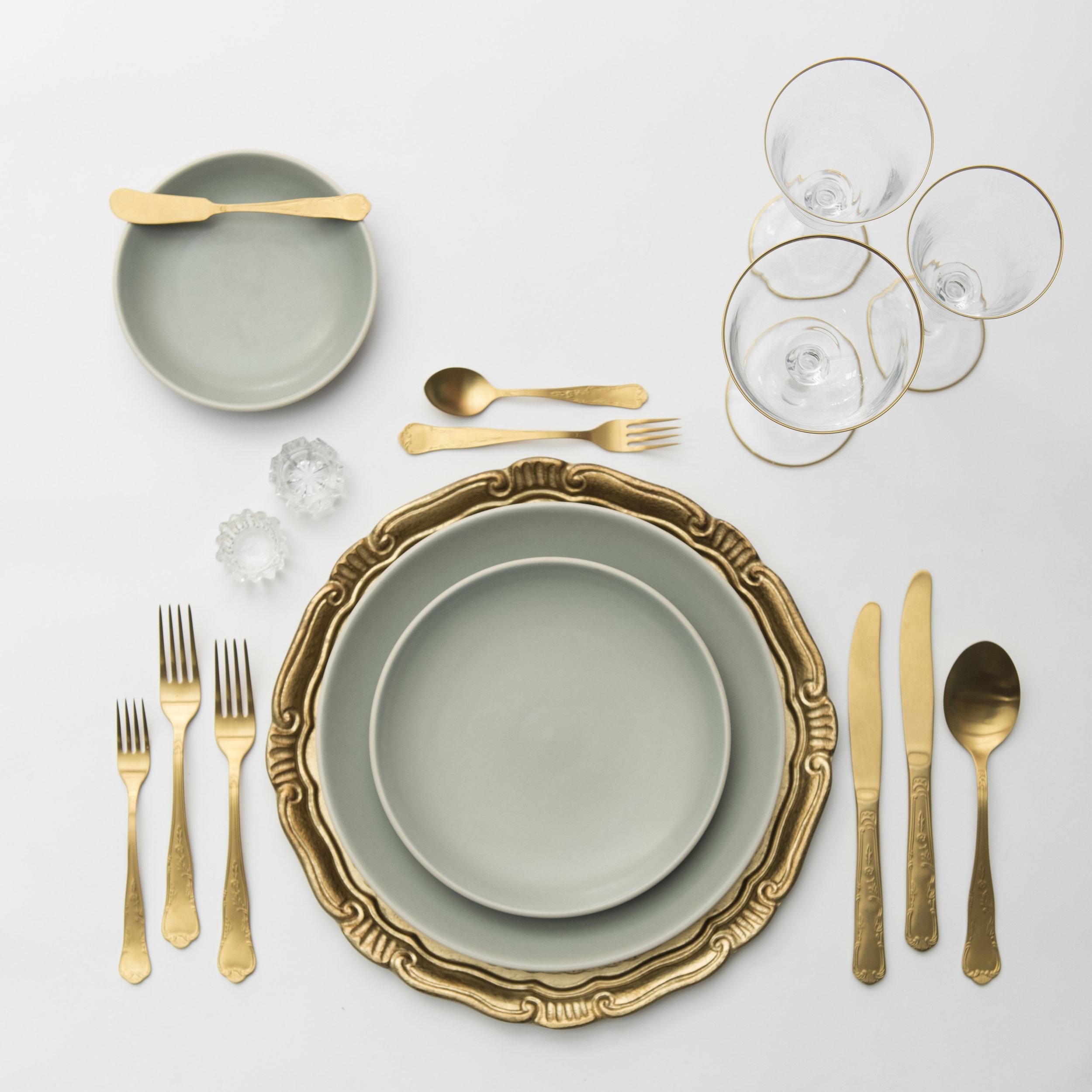 RENT: Florentine Charger in Gold + Heath Ceramics in Mist + Chateau Flatware in Matte Gold + Chloe 24k Gold Rimmed Stemware + Antique Crystal Salt Cellars  SHOP:Chloe 24k Gold Rimmed Stemware