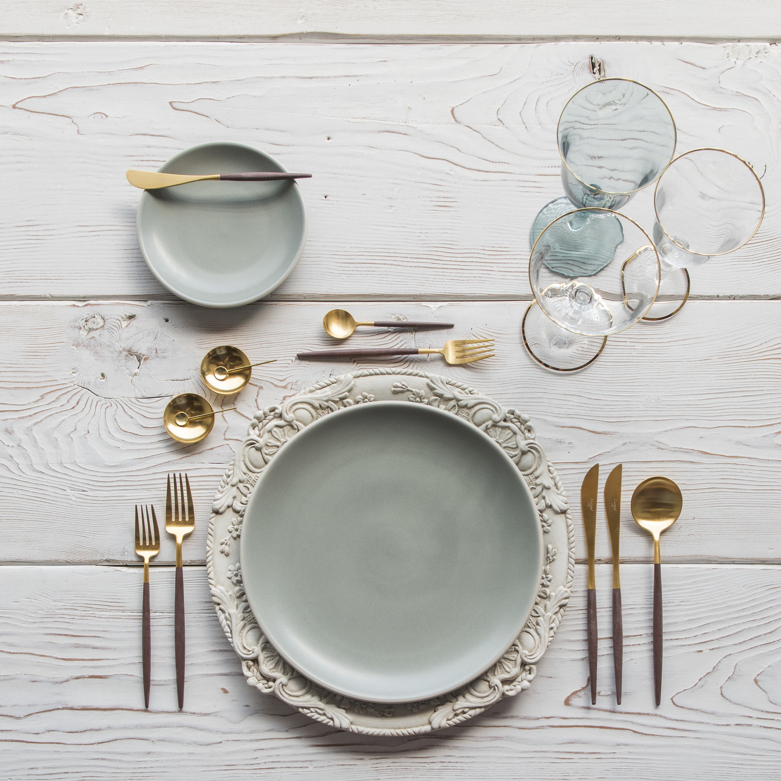 RENT: Verona Chargers in Antique White + Heath Ceramics in Mist + Goa Flatware in Brushed 24k Gold/Wood + Chloe 24k Gold Rimmed Stemware + Chloe 24k Gold Rimmed Goblet in Agave + 14k Gold Salt Cellars + Tiny Gold Spoons  SHOP: Verona Chargers in Antique White + Goa Flatware in Brushed 24k Gold/Wood + Chloe 24k Gold Rimmed Stemware + 14k Gold Salt Cellars + Tiny Gold Spoons