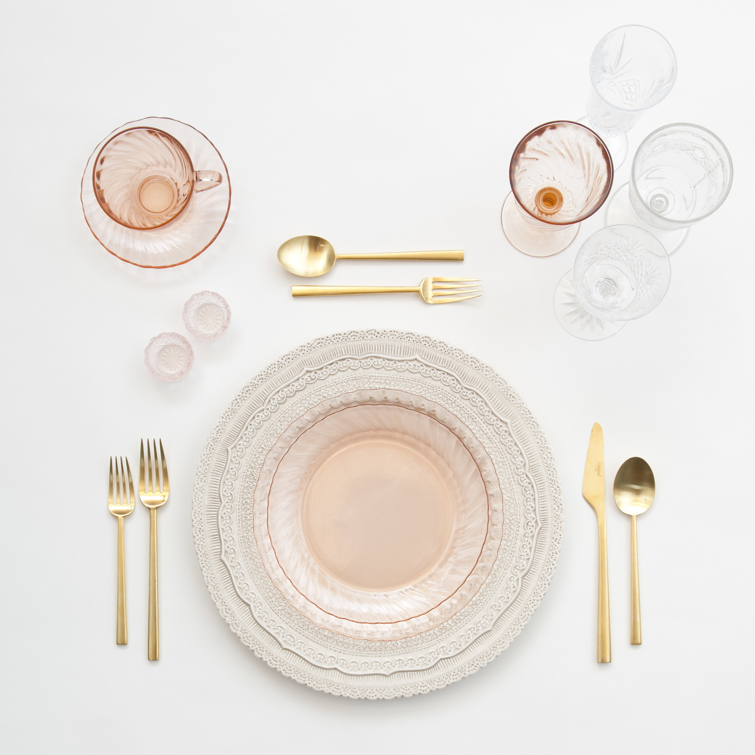 RENT: Lace Chargers in White + Pink Swirl Collection Plates + Rondo Flatware in Brushed 24k Gold + Vintage Pink Swirl Goblets + Vintage Champagne Flutes + Early American Pressed Glass Goblets + Vintage Cut Crystal Goblets + Pink Crystal Salt Cellars  SHOP: Rondo Flatware in Brushed 24k Gold