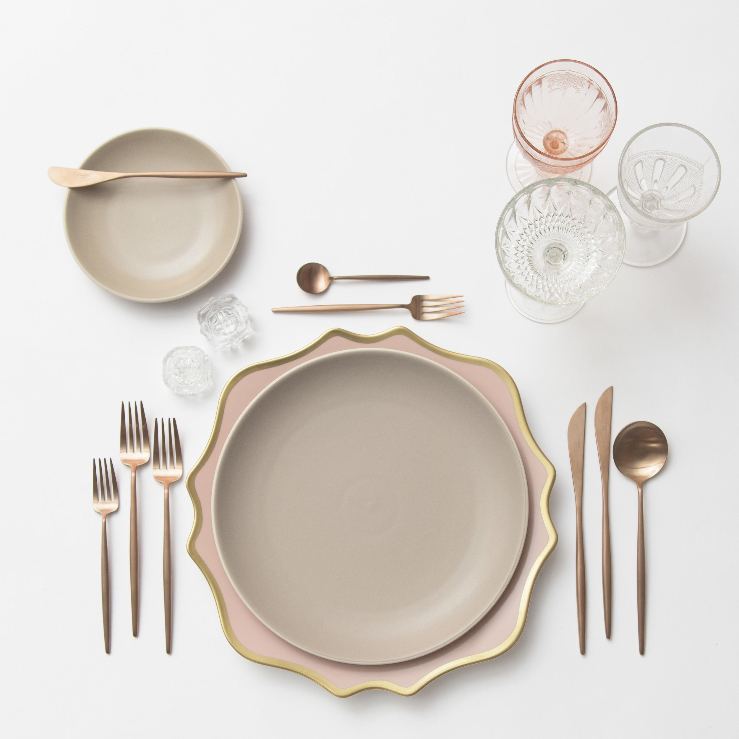 RENT: Anna Weatherley Chargers in Desert Rose/Gold + Heath Ceramics in French Grey + Moon Flatware in Brushed Rose Gold + Pink Vintage Goblets + Early American Pressed Glass Goblets + Vintage Champagne Coupes + Antique Crystal Salt Cellars  SHOP: Moon Flatware in Brushed Rose Gold