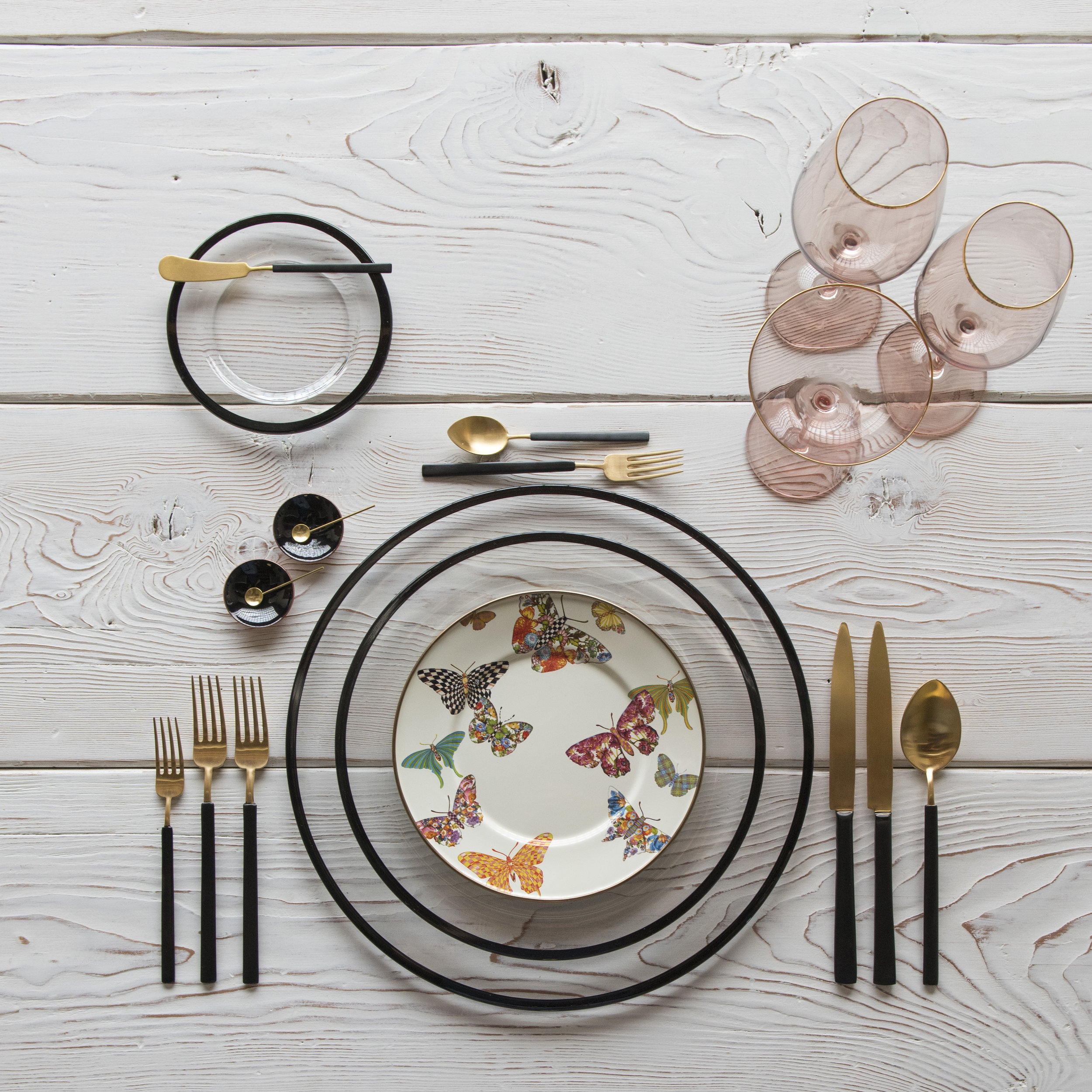 RENT: Halo Glass Chargers/Dinnerware in Black + MacKenzie-Childs Butterfly Garden Collection + Axel Flatware in Matte 24k Gold/Black + Bella 24k Gold Rimmed Stemlware in Blush + Black Enamel Salt Cellars + Tiny Gold Spoons  SHOP: Halo Glass Chargers/Dinnerware in Black + Bella 24k Gold Rimmed Stemware in Blush + Black Enamel Salt Cellars + Tiny Gold Spoons