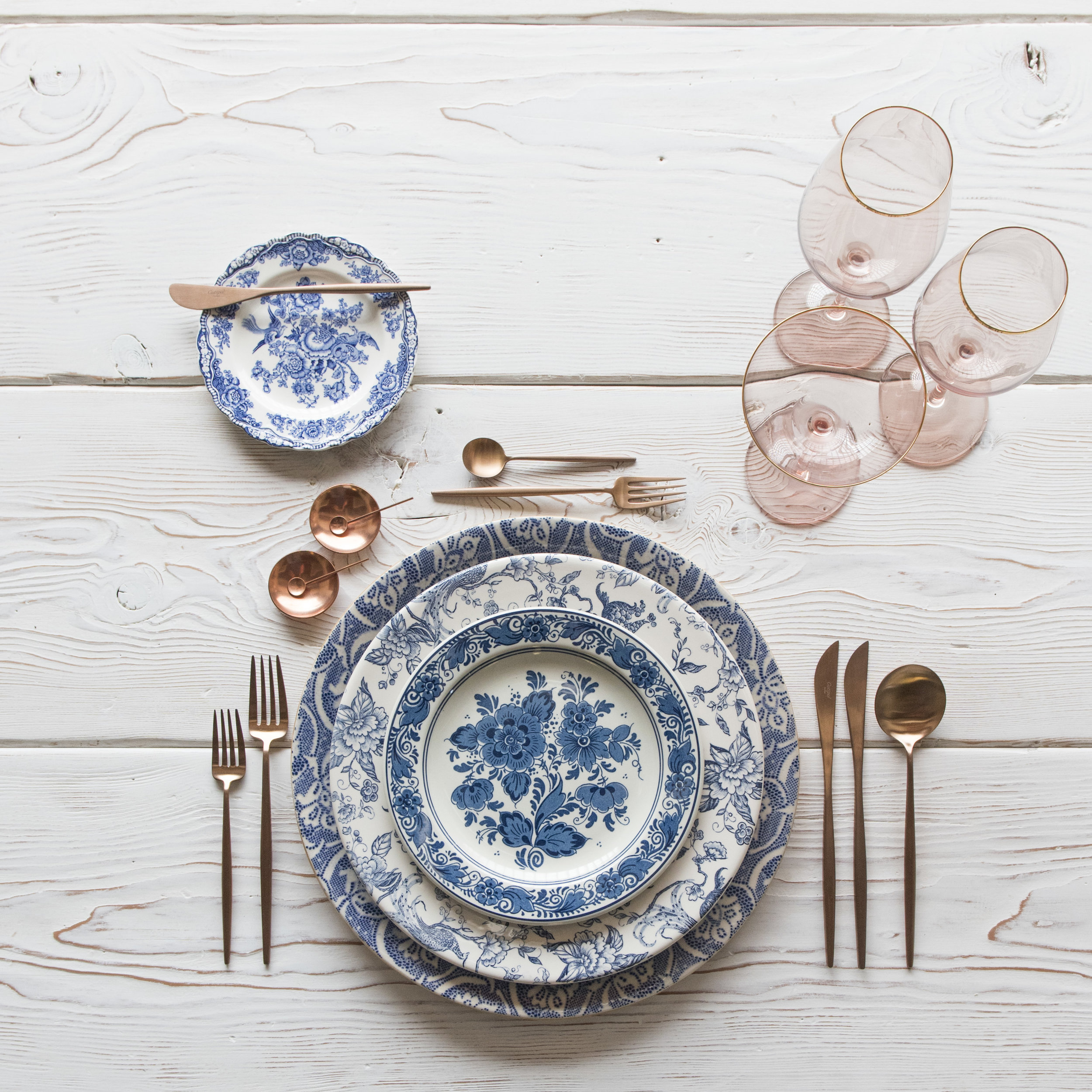 RENT: Blue Fleur de Lis Chargers + Blue Garden Collection Vintage China + Moon Flatware in Brushed Rose Gold + Bella 24k Gold Rimmed Stemware in Blush + Copper Salt Cellars + Tiny Copper Spoons   SHOP: Moon Flatware in Brushed Rose Gold + Bella 24k Gold Rimmed Stemware in Blush + Copper Salt Cellars + Tiny Copper Spoons
