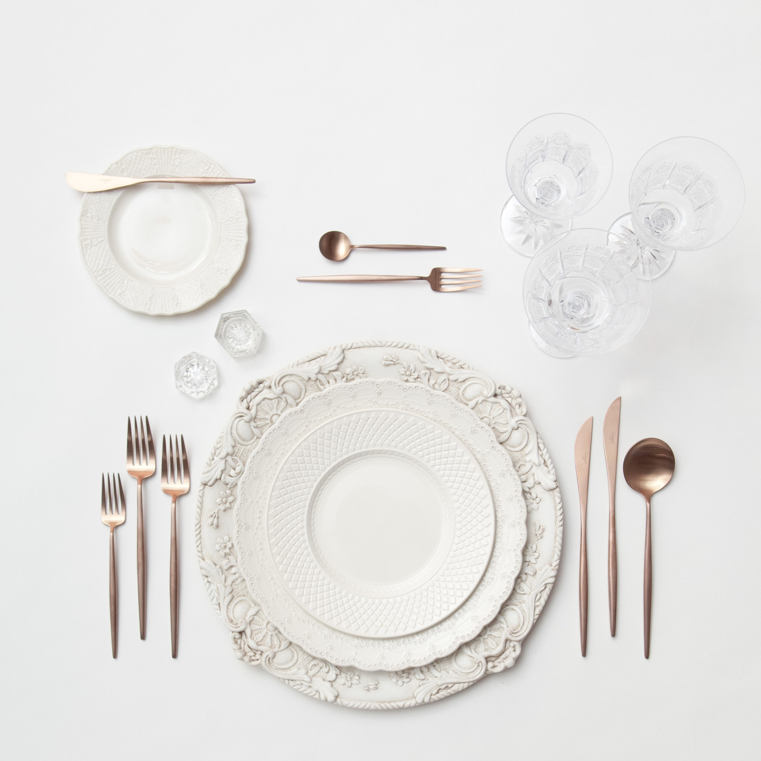 RENT: Verona Chargers in Antique White + White Collection Vintage China + Moon Flatware in Brushed Rose Gold + Czech Crystal Stemware + Antique Crystal Salt Cellars  SHOP:Verona Chargers in Antique White +Moon Flatware in Brushed Rose Gold