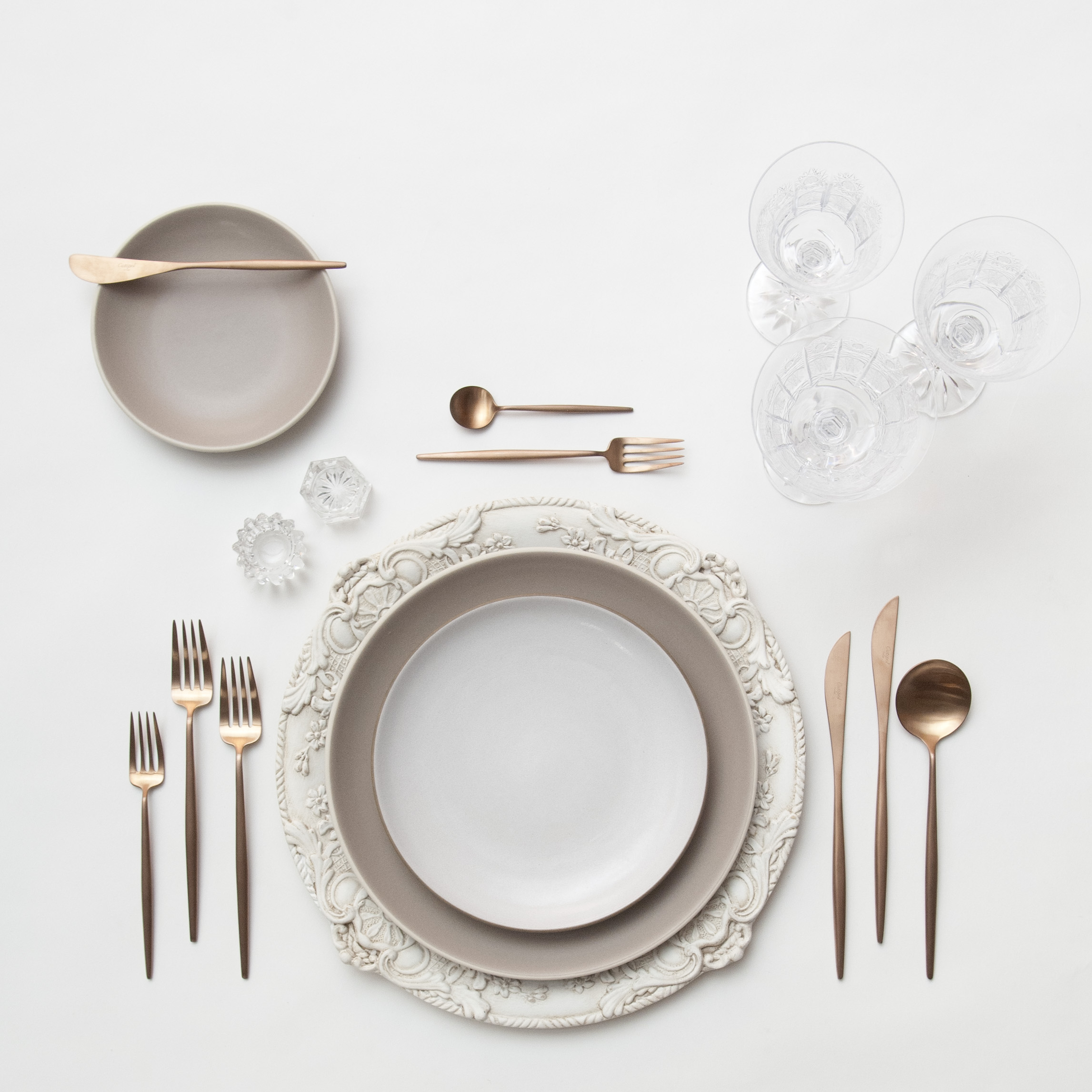 RENT: Verona Chargers in Antique White + Heath Ceramics in French Grey/Opaque White + Moon Flatware in Brushed Rose Gold + Czech Crystal Stemware + Antique Crystal Salt Cellars  SHOP:Verona Chargers in Antique White + Moon Flatware in Brushed Rose Gold