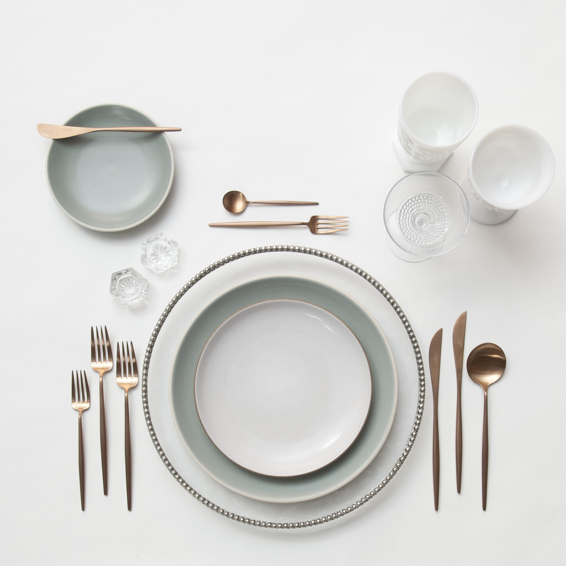 RENT: Pavé Glass Chargers in Pewter + Heath Ceramics in Mist/Opaque White + Moon Flatware in Brushed Rose Gold + Milk Glass Vintage Goblets + Vintage Champagne Coupes + Antique Crystal Salt Cellars  SHOP: Moon Flatware in Brushed Rose Gold