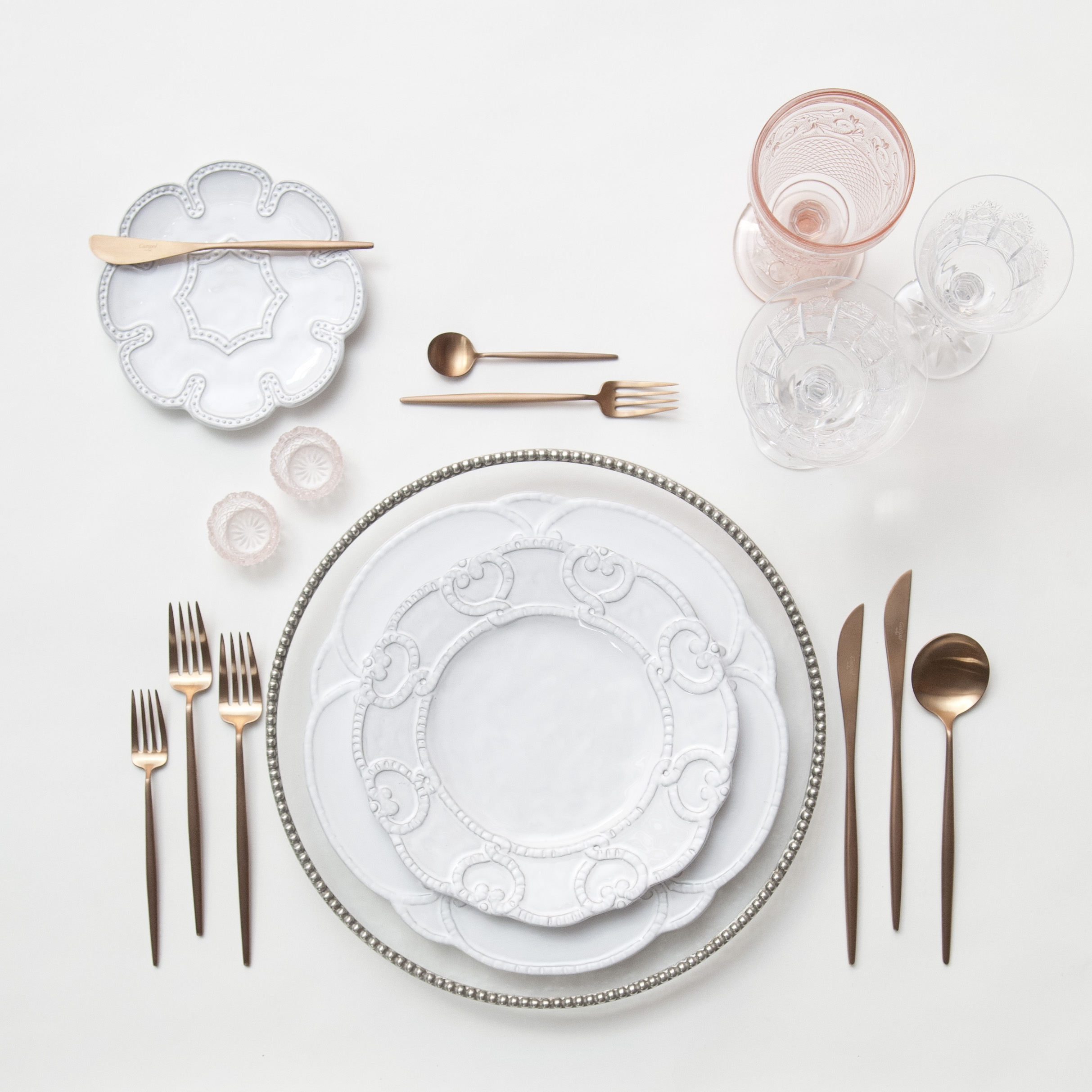 RENT: Pavé Glass Chargers in Pewter + Signature Collection Dinnerware + Moon Flatware in Brushed Rose Gold + Vintage Pink Goblets + Czech Crystal Stemware + Pink Crystal Salt Cellars  SHOP: Moon Flatware in Brushed Rose Gold