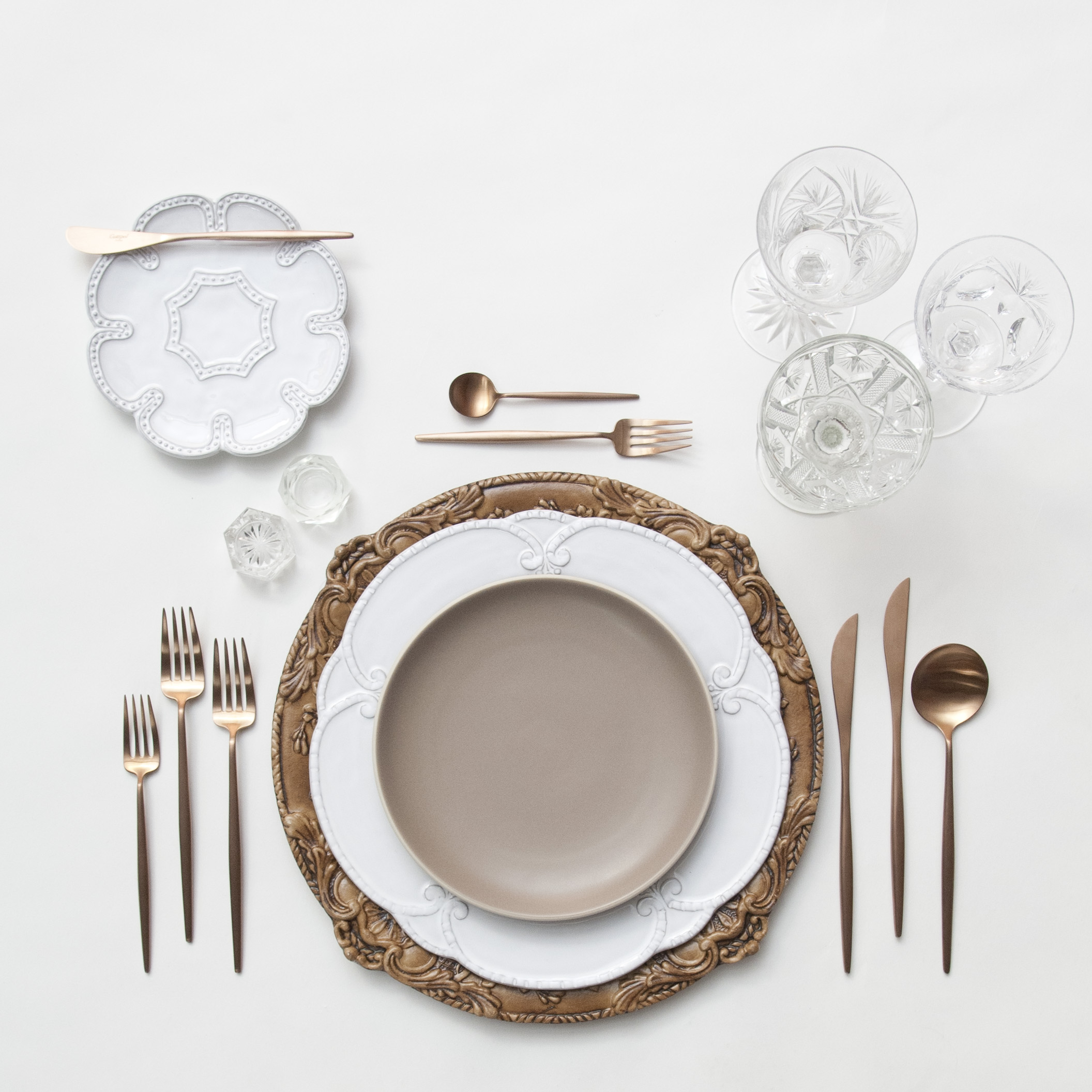 RENT: Verona Chargers in Walnut + Signature Collection Dinnerware + Heath Ceramics in French Grey + Moon Flatware in Brushed Rose Gold + Vintage Cut Crystal Goblets + Vintage Champagne Coupes + Antique Crystal Salt Cellars  SHOP:Verona Chargers in Walnut +Moon Flatware in Brushed Rose Gold