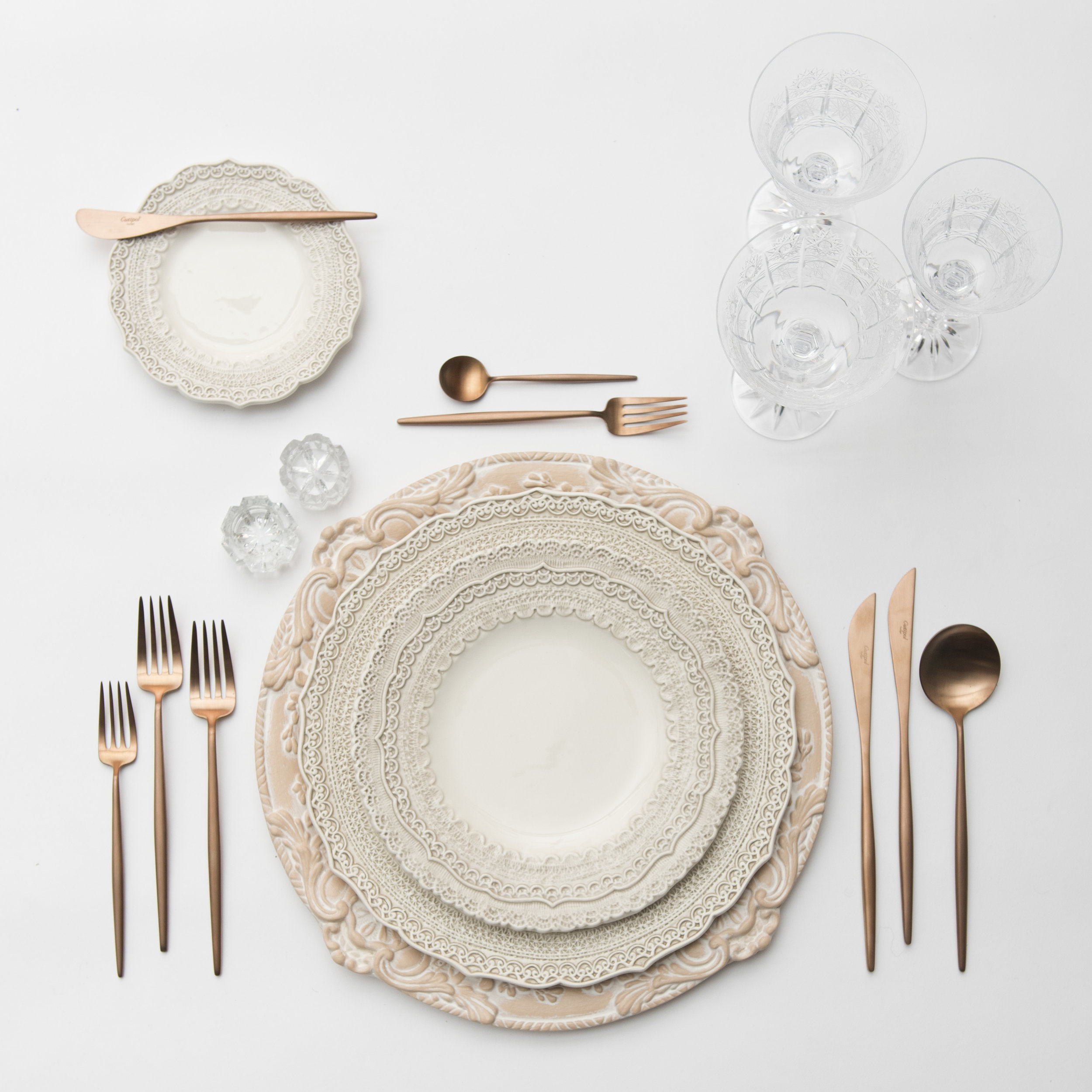 RENT: Verona Chargers in Terracotta + Lace Dinnerware in White + Moon Flatware in Brushed Rose Gold + Czech Crystal Stemware + Antique Crystal Salt Cellars  SHOP:Verona Chargers in Terracotta +Moon Flatware in Brushed Rose Gold