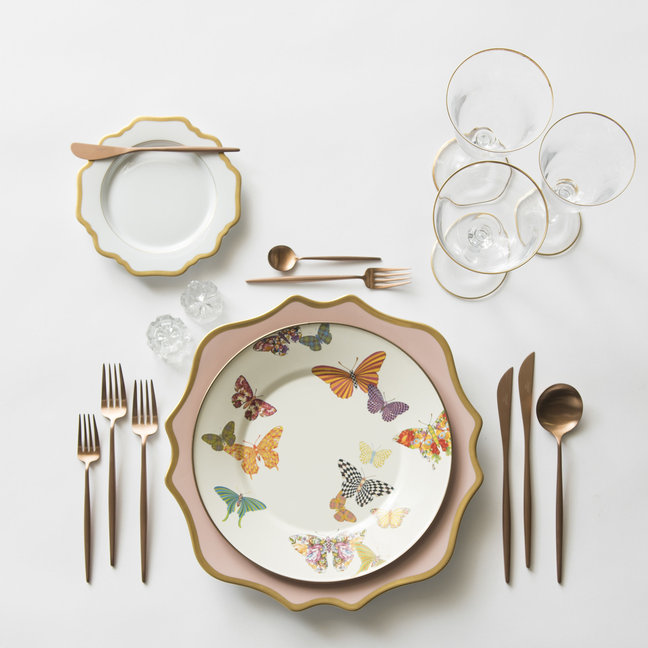 RENT: Anna Weatherley Chargers in Desert Rose/Gold + MacKenzie-Childs Butterfly Garden Collection + Anna Weatherley Dinnerware in White/Gold + Moon Flatware in Brushed Rose Gold + Chloe 24k Gold Rimmed Stemware + Antique Crystal Salt Cellars  SHOP:Anna Weatherley Dinnerware in White/Gold +Moon Flatware in Brushed Rose Gold + Chloe 24k Gold Rimmed Stemware