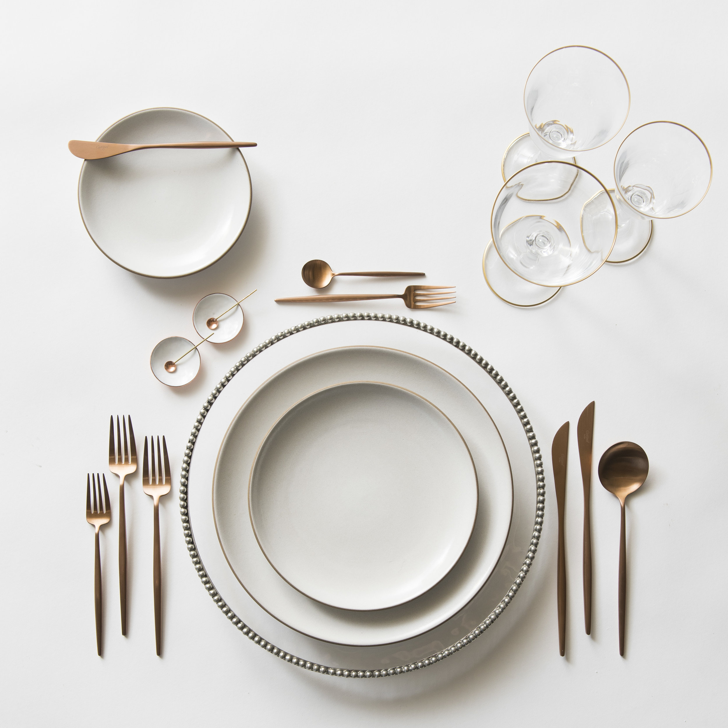 RENT: Pav é Glass Chargers in Pewter + Heath Ceramics in Opaque White + Moon Flatware in Brushed Rose Gold + Chloe 24k Gold Rimmed Stemware + White Enamel Salt Cellars + Tiny Gold/Copper Spoons   SHOP: Moon Flatware in Rose Gold + Chloe 24k Gold Rimmed Stemware + White Enamel Salt Cellars
