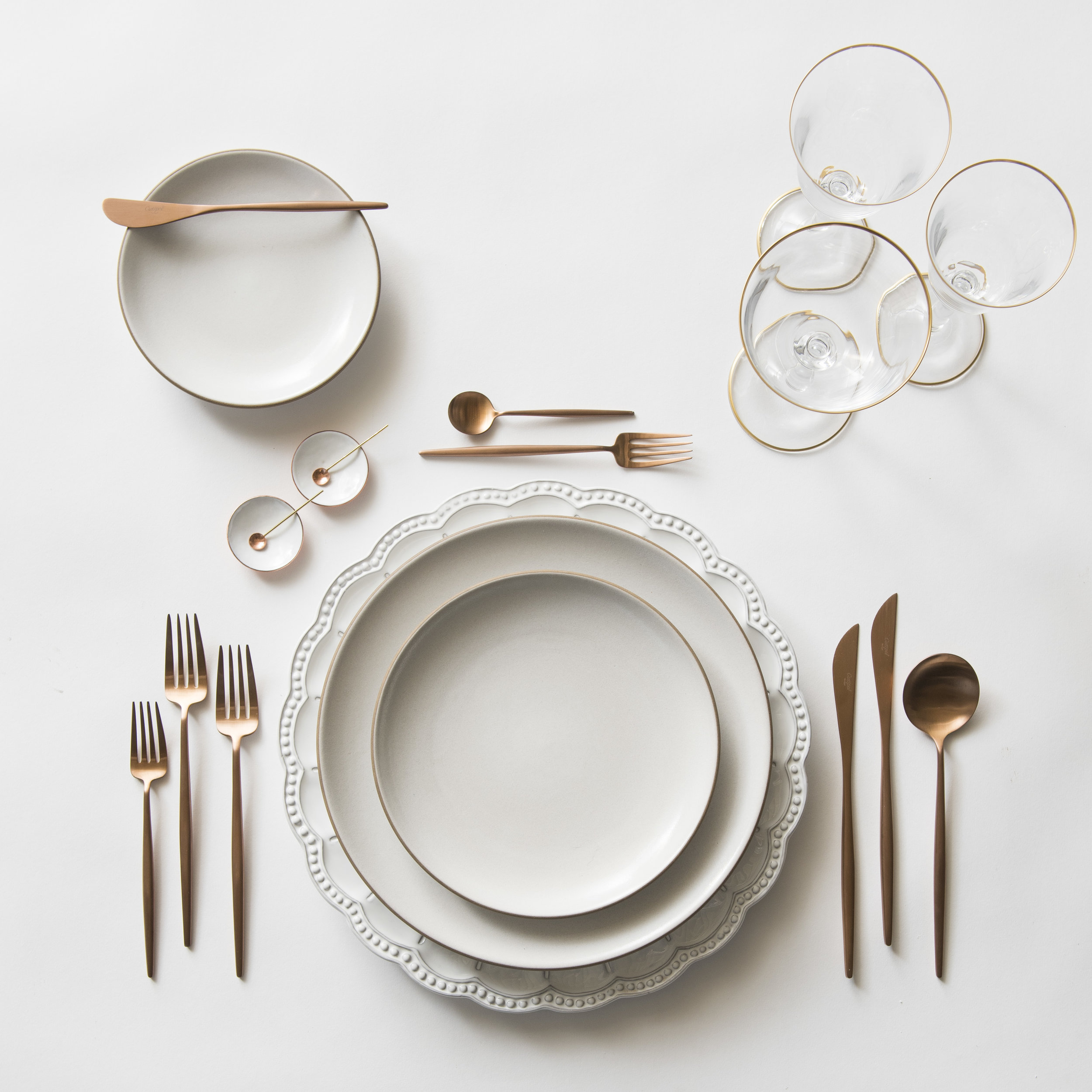 RENT: Signature Collection Chargers + Heath Ceramics in Opaque White + Moon Flatware in Brushed Rose Gold + Chloe 24k Gold Rimmed Stemware + White Enamel Salt Cellars + Tiny Gold/Copper Spoons   SHOP: Moon Flatware in Rose Gold + Chloe 24k Gold Rimmed Stemware + White Enamel Salt Cellars