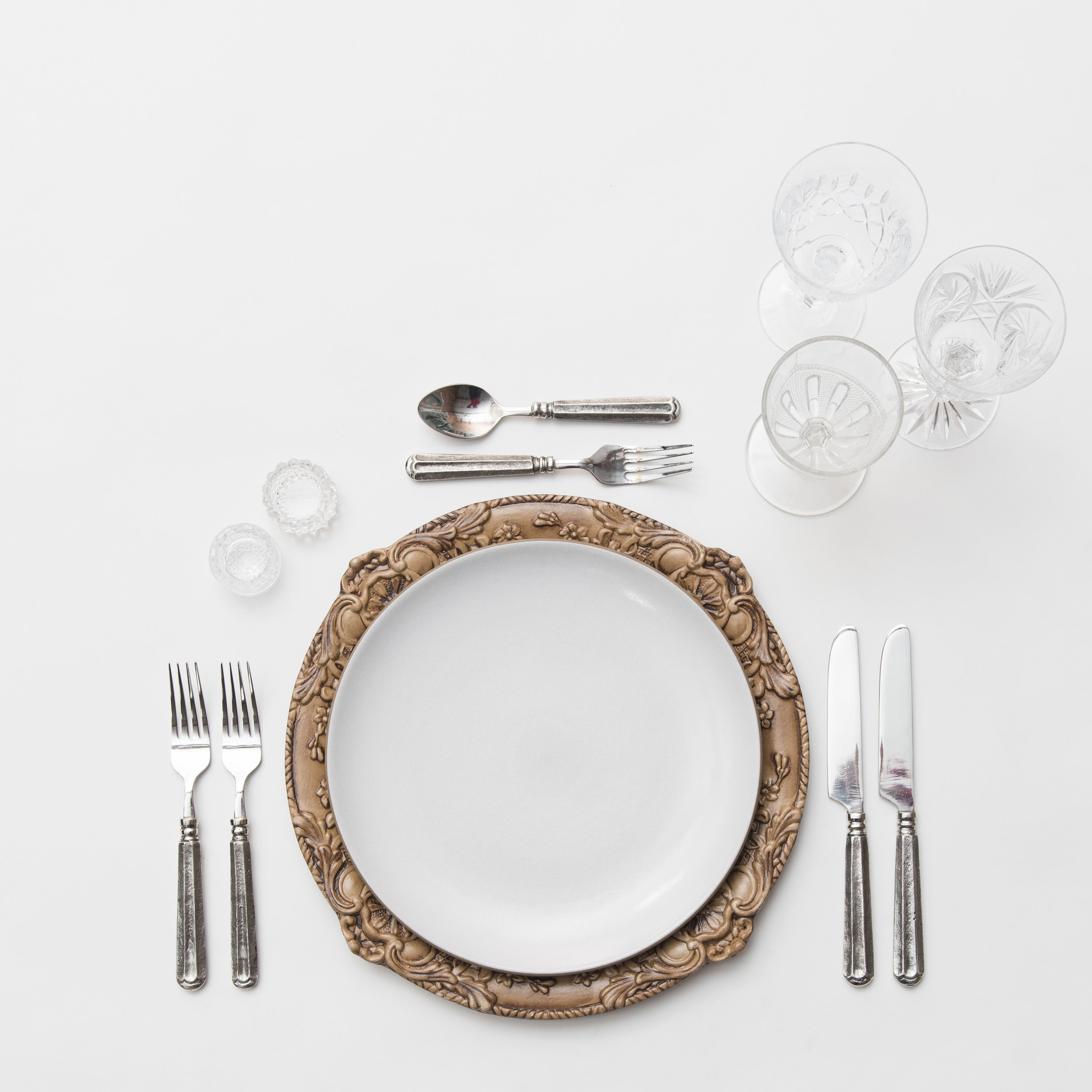 RENT: Verona Chargers in Walnut + Heath Ceramics in Opaque White + Tuscan Flatware in Pewter + Vintage Cut Crystal Goblets + Early American Pressed Glass Goblets + Antique Crystal Salt Cellars  SHOP:Verona Chargers in Walnut