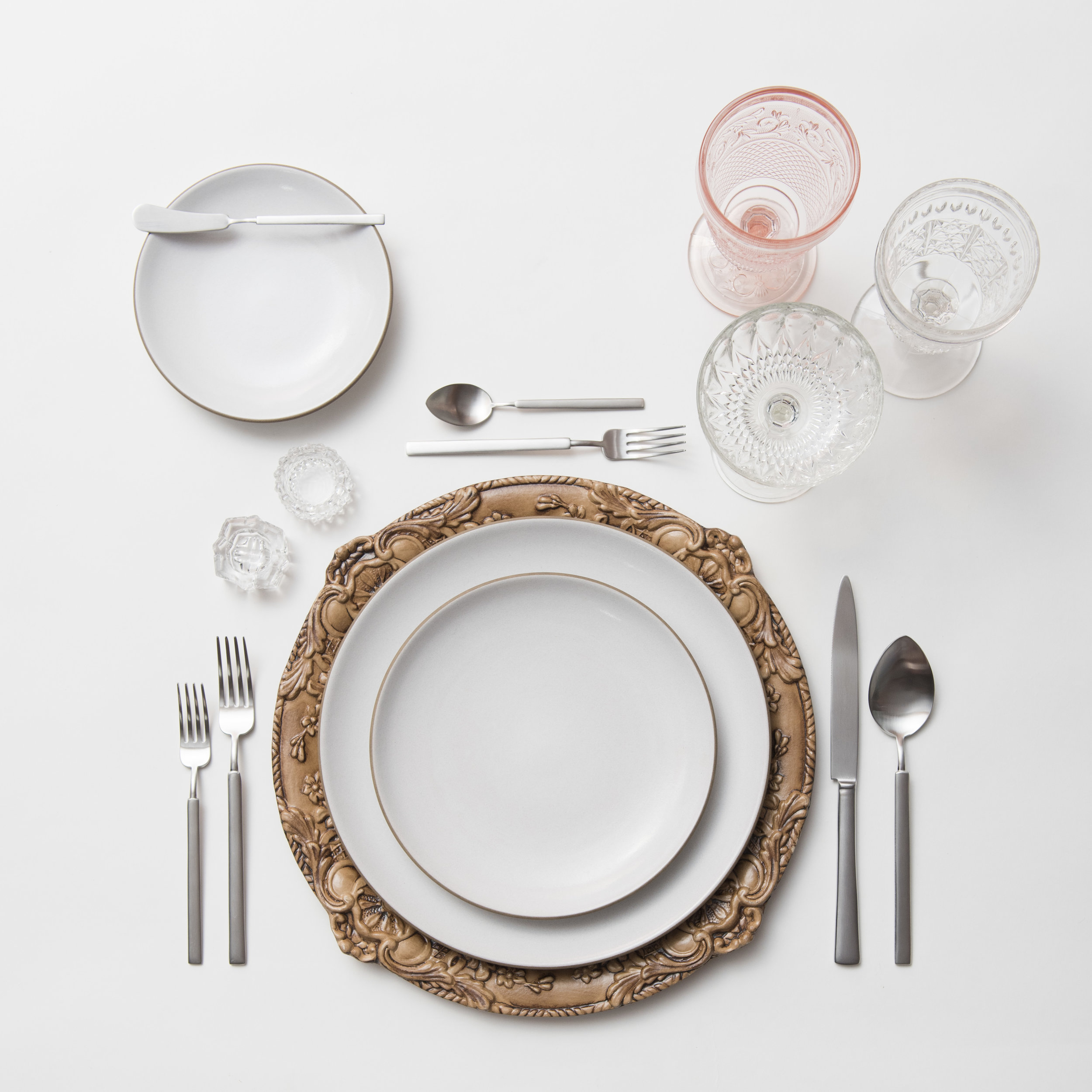 RENT: Verona Chargers in Walnut + Heath Ceramics in Opaque White + Axel Flatware in Matte Silver + Pink Vintage Goblets + Early American Pressed Glass Goblets + Vintage Champagne Coupes + Antique Crystal Salt Cellars  SHOP:Verona Chargers in Walnut
