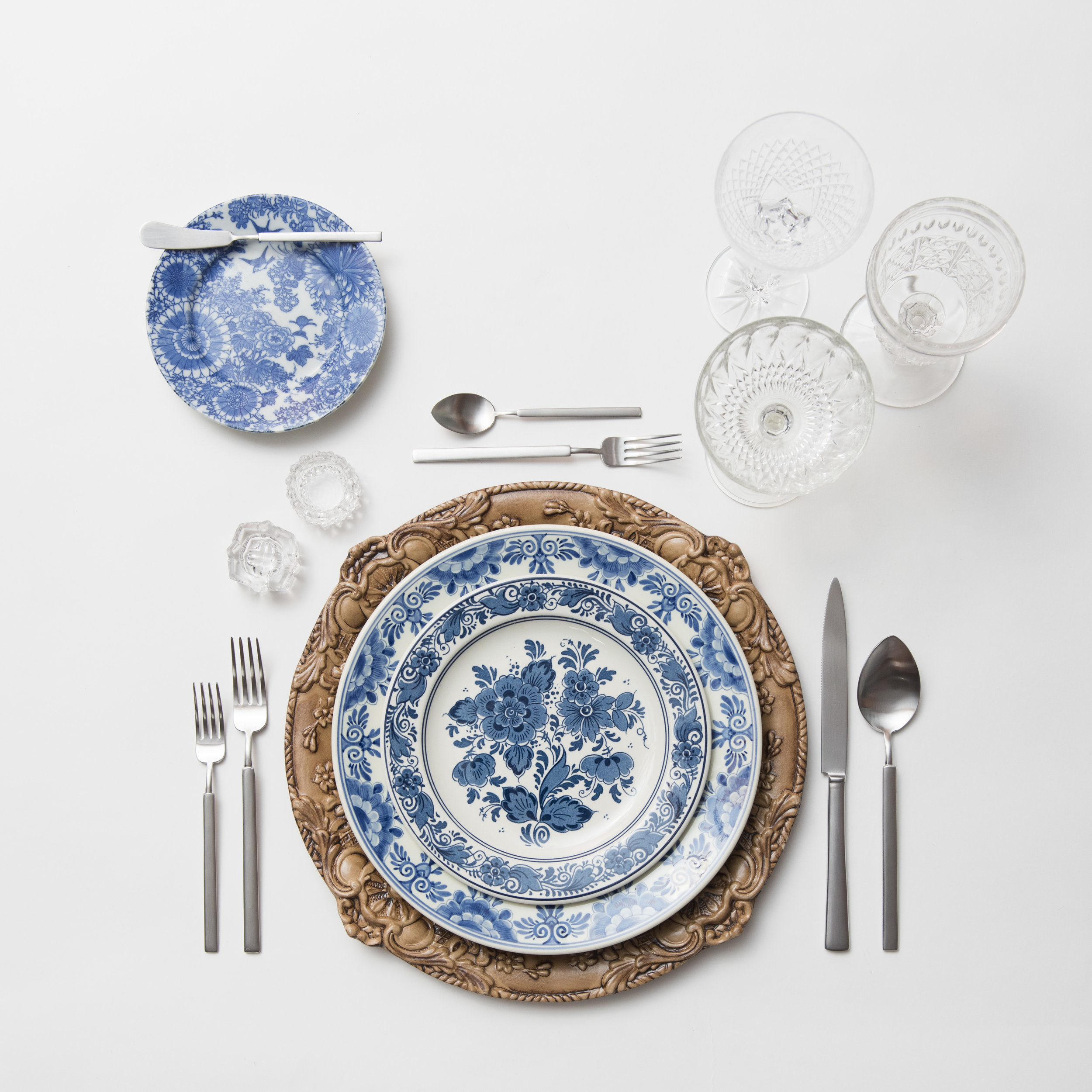 RENT: Verona Chargers in Walnut + Blue Garden Collection Vintage China + Axel Flatware in Matte Silver + Vintage Cut Crystal Goblets + Early American Pressed Glass Goblets + Vintage Champagne Coupes + Antique Crystal Salt Cellars  SHOP:Verona Chargers in Walnut