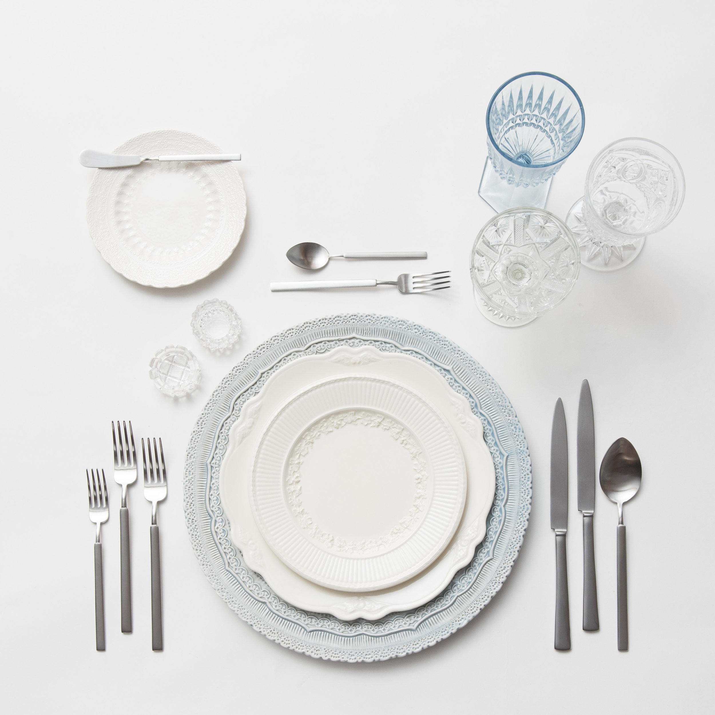 RENT: Lace Chargers in Dusty Blue + White Collection Vintage China + Axel Flatware in Matte Silver + Light Blue Vintage Goblets + Early American Pressed Glass Goblets + Vintage Champagne Coupes + Antique Crystal Salt Cellars