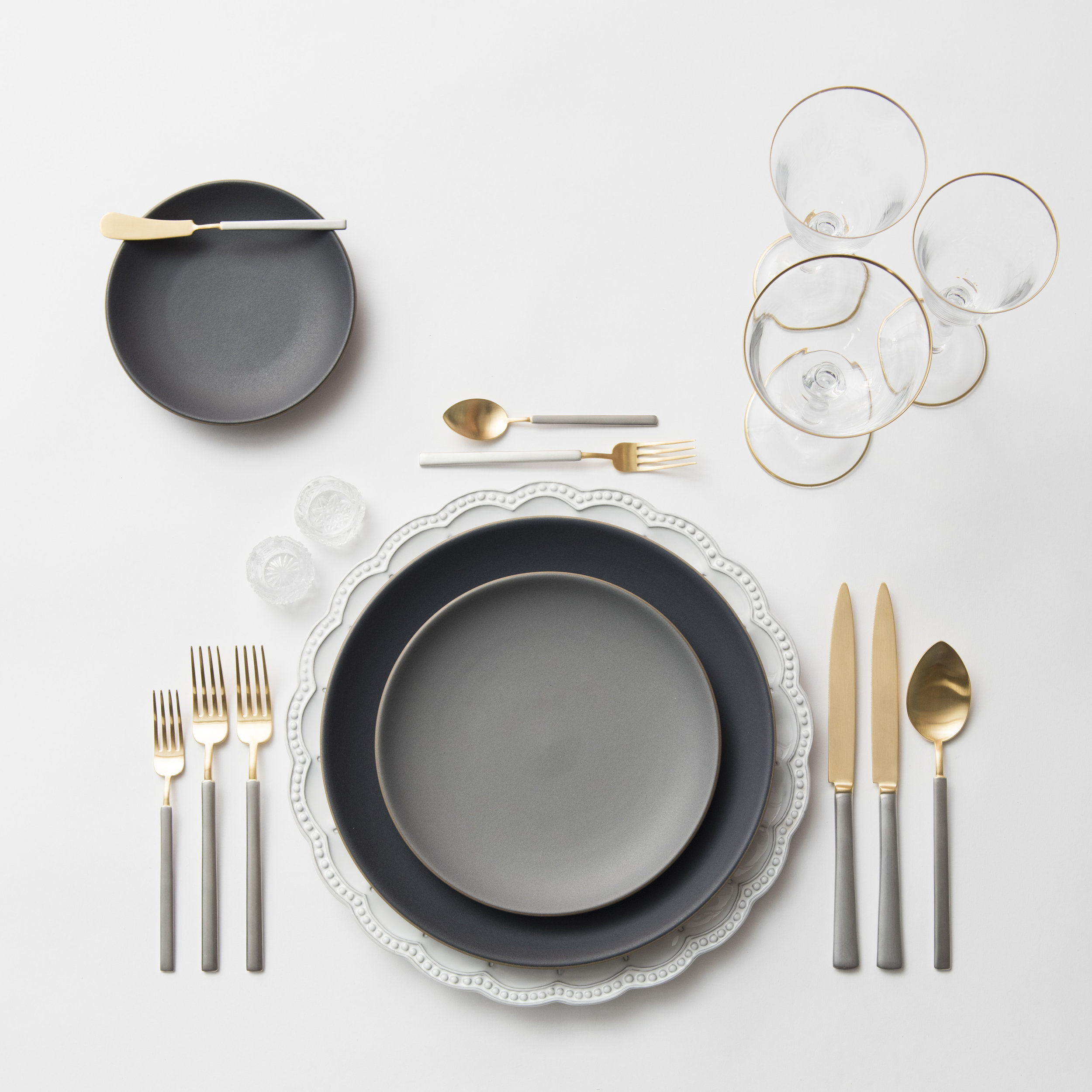 RENT: Signature Collection Chargers + Heath Ceramics in Indigo/Slate + Axel Flatware in Matte 24k Gold/Silver + Chloe 24k Gold Rimmed Stemware + Antique Crystal Salt Cellars  SHOP:Chloe 24k Gold Rimmed Stemware