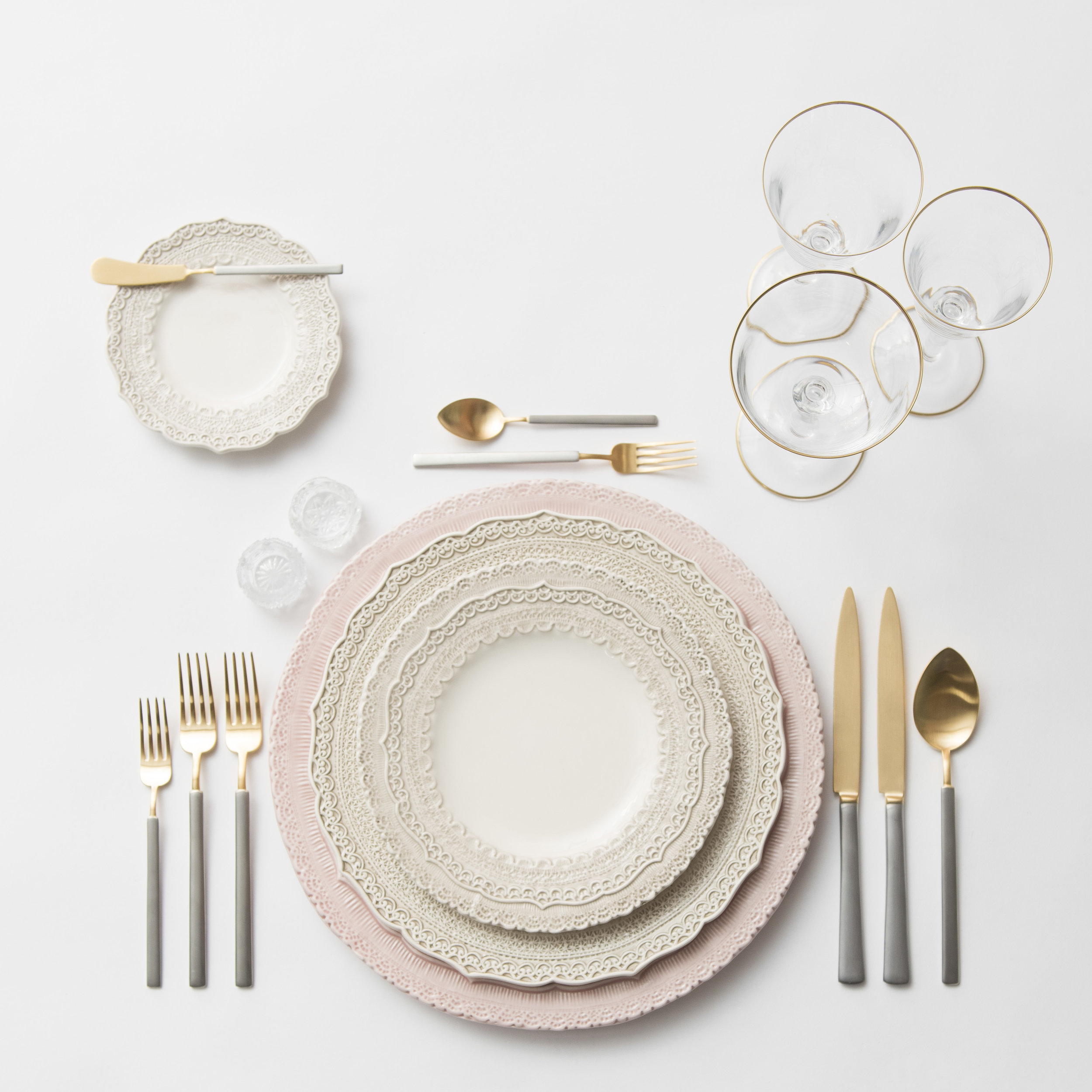 RENT: Lace Chargers in Blush + Lace Dinnerware in White + Axel Flatware in Matte 24k Gold/Silver + Chloe 24k Gold Rimmed Stemware + Antique Crystal Salt Cellars  SHOP:Chloe 24k Gold Rimmed Stemware