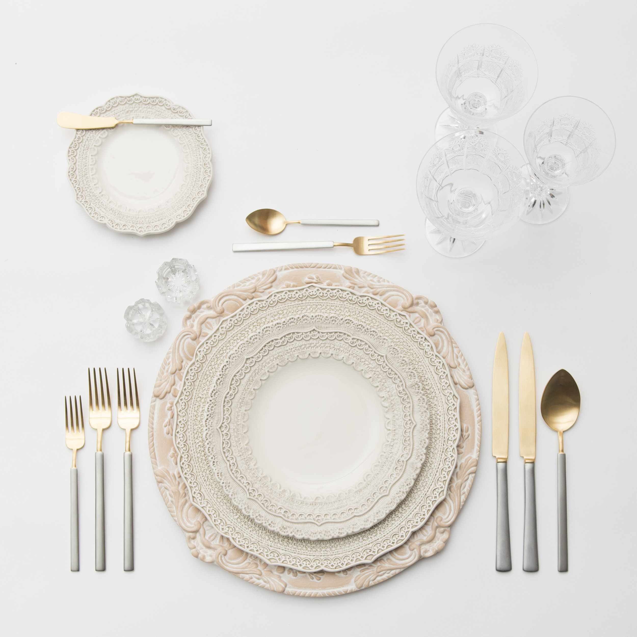 RENT: Verona Chargers in Terracotta + Lace Dinnerware in White + Axel Flatware in Matte 24k Gold/Silver + Czech Crystal Stemware + Antique Crystal Salt Cellars  SHOP:Verona Chargers in Terracotta
