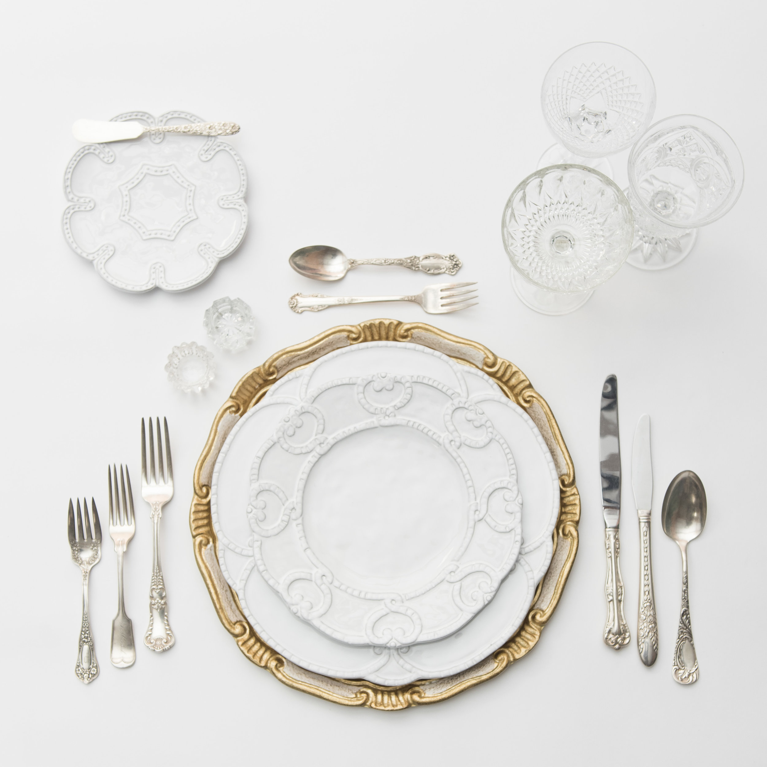 RENT: Florentine Chargers in White/Gold + Signature Collection Dinnerware + Antique Silver Flatware + Vintage Cut Crystal Goblets + Early American Pressed Glass Goblets + Vintage Champagne Coupes + Antique Crystal Salt Cellars  SHOP:Florentine Chargers in White/Gold